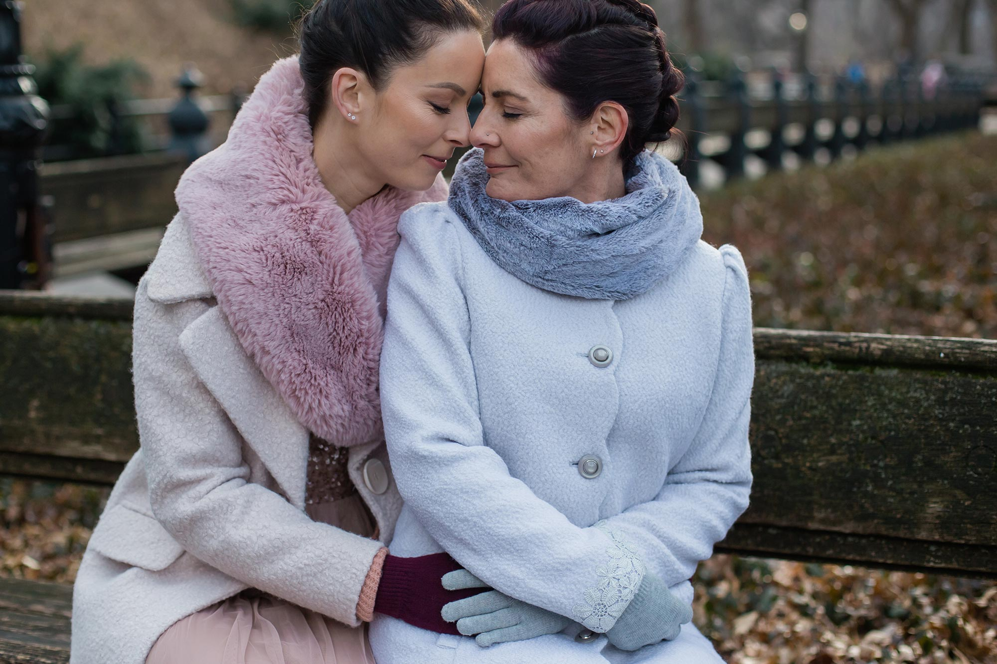 queer irish central park winter elopement kate alison photography embrace on bench