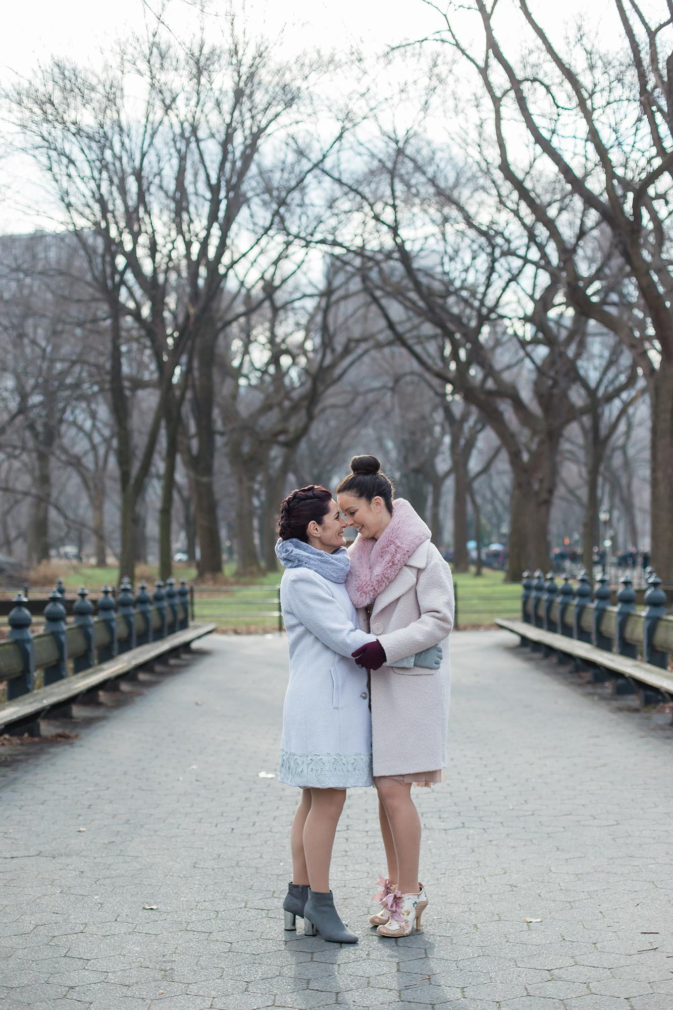 queer irish central park winter elopement kate alison photography embrace on stone path