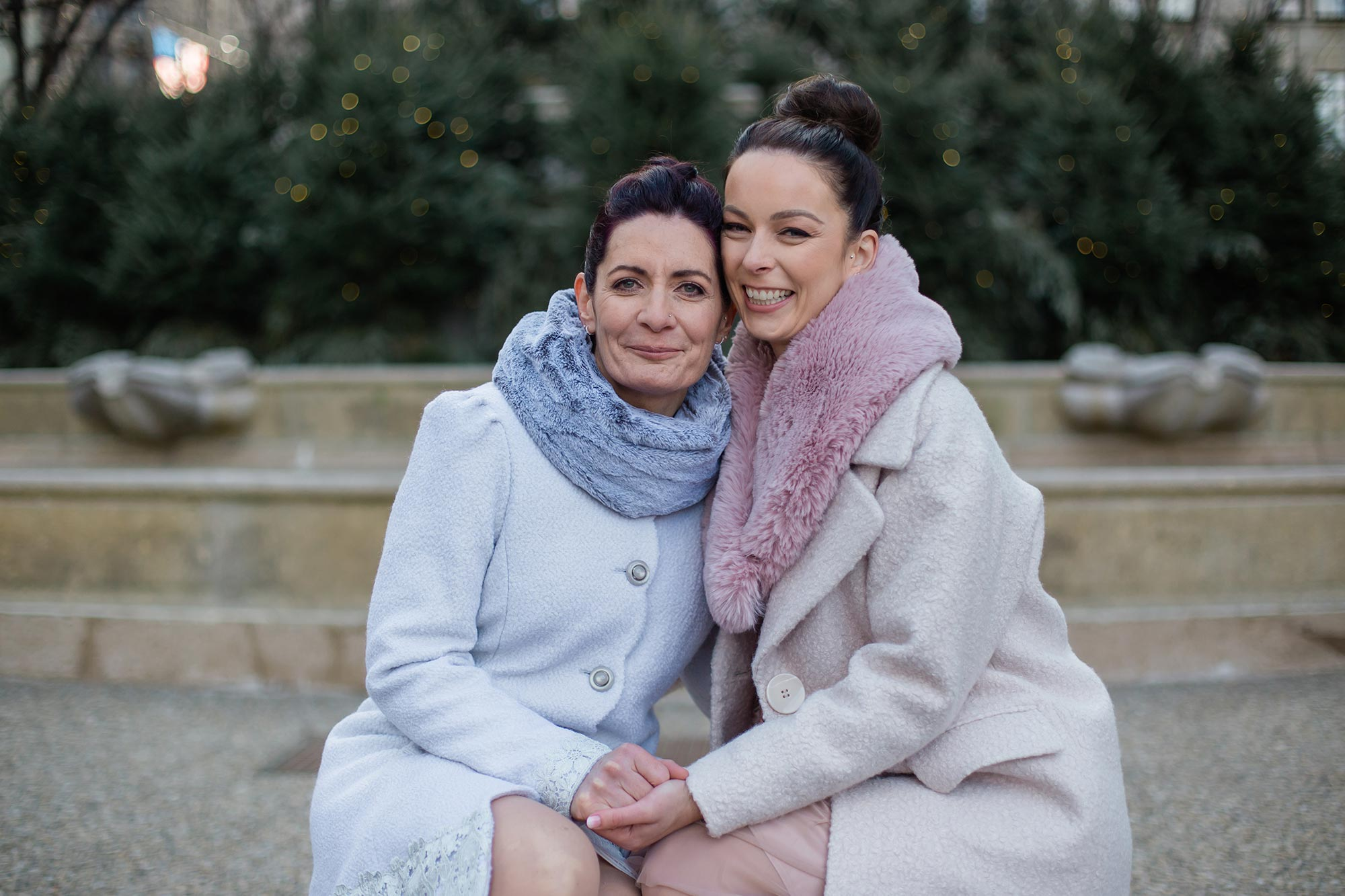 queer irish central park winter elopement kate alison photography brides sitting on low step smiling