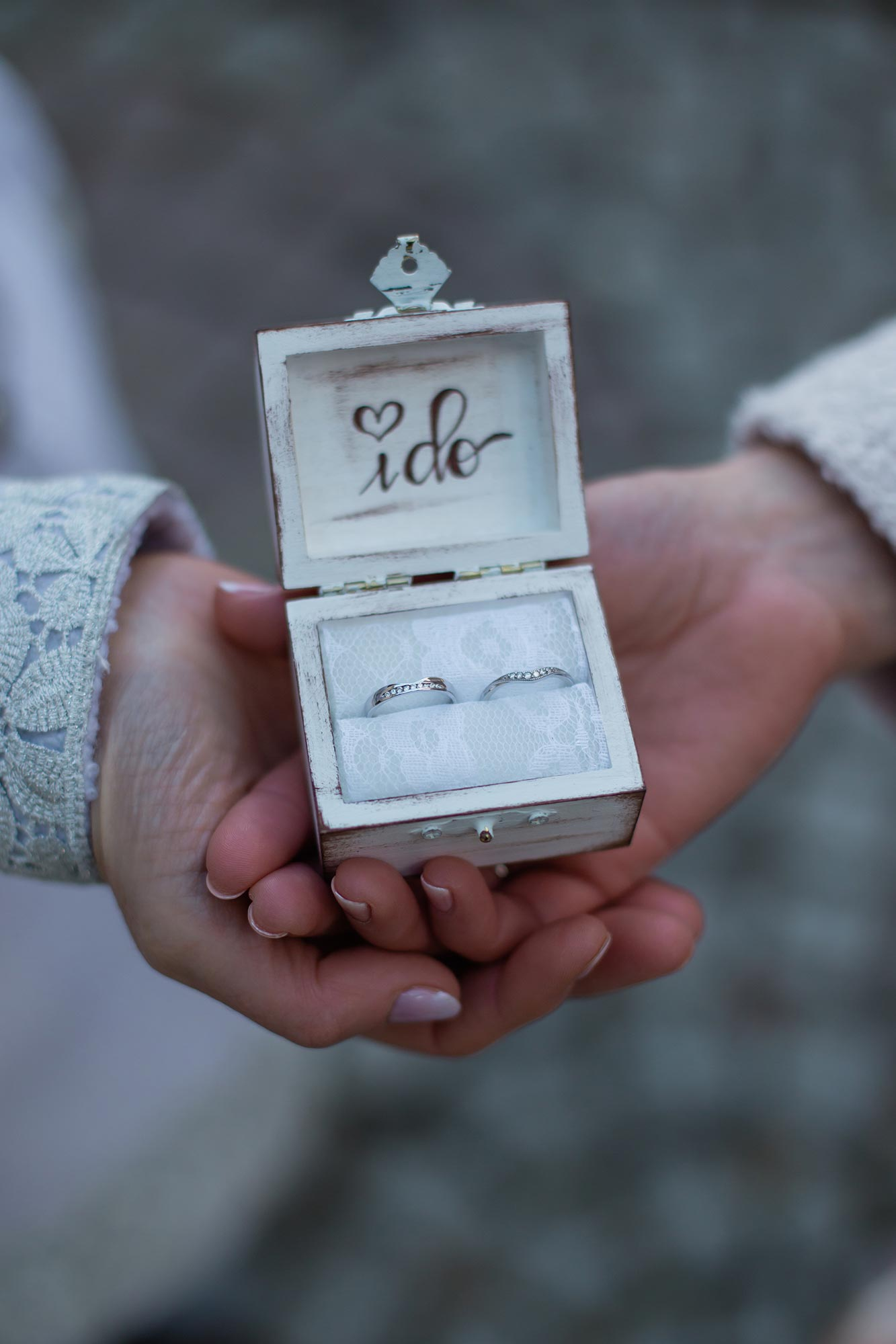 """queer irish central park winter elopement kate alison photography kathryn and mary holding ring box with their rings, """"I do"""" written in box lid"""