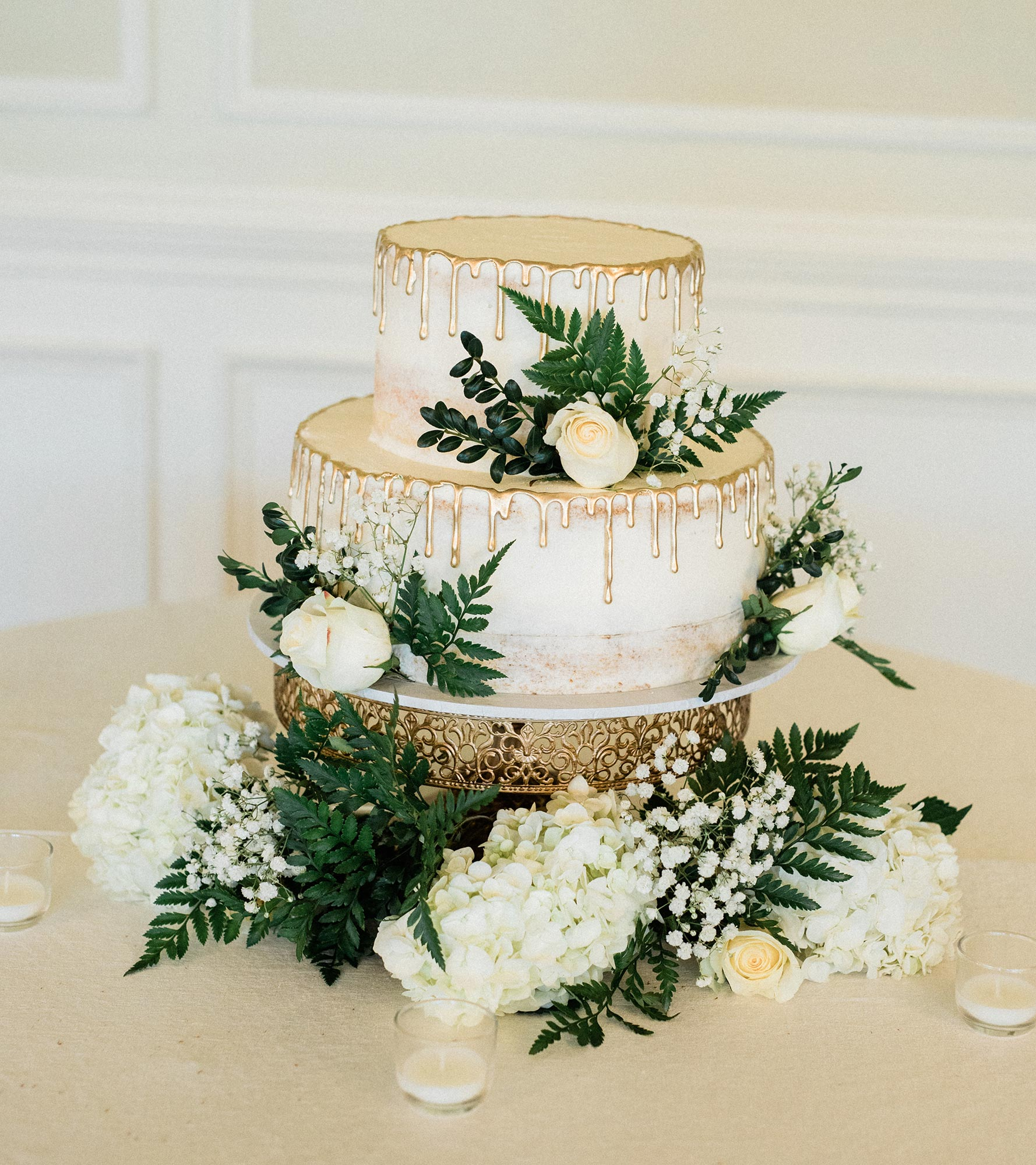 Chic Queer Wedding in West Chester Pennsylvania showing gold wedding cake Judson Rappaport Photography