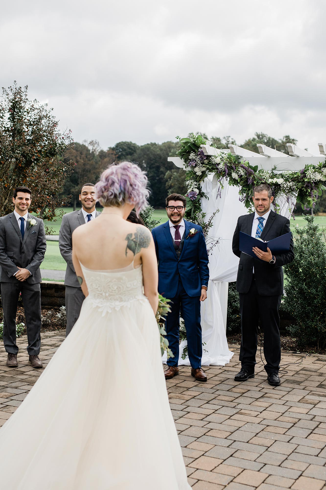 Chic Queer Wedding in West Chester Pennsylvania showing Sara walking down aisle Judson Rappaport Photography