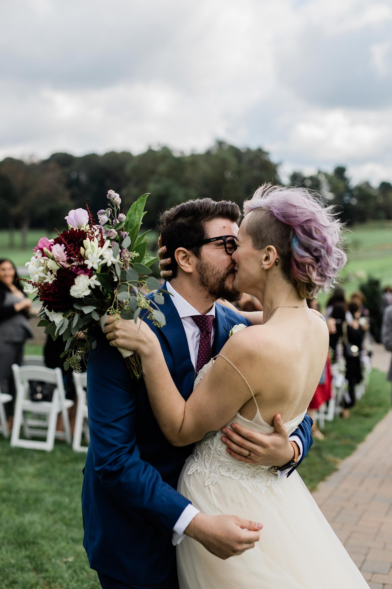 Chic Queer Wedding in West Chester Pennsylvania showing couple kissing after ceremony Judson Rappaport Photography