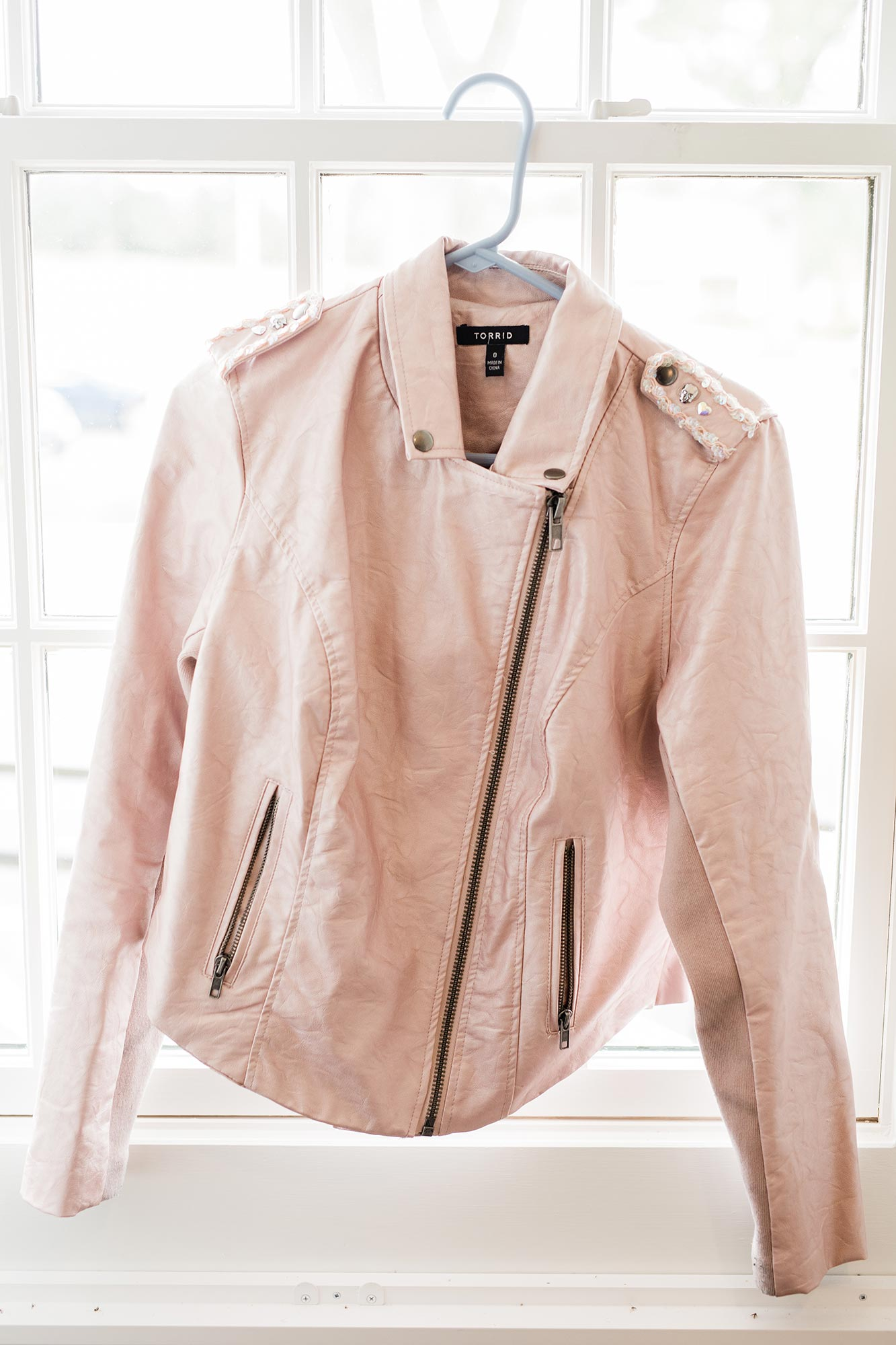 Chic Queer Wedding in West Chester Pennsylvania showing Sara's pink leather jacket Judson Rappaport Photography