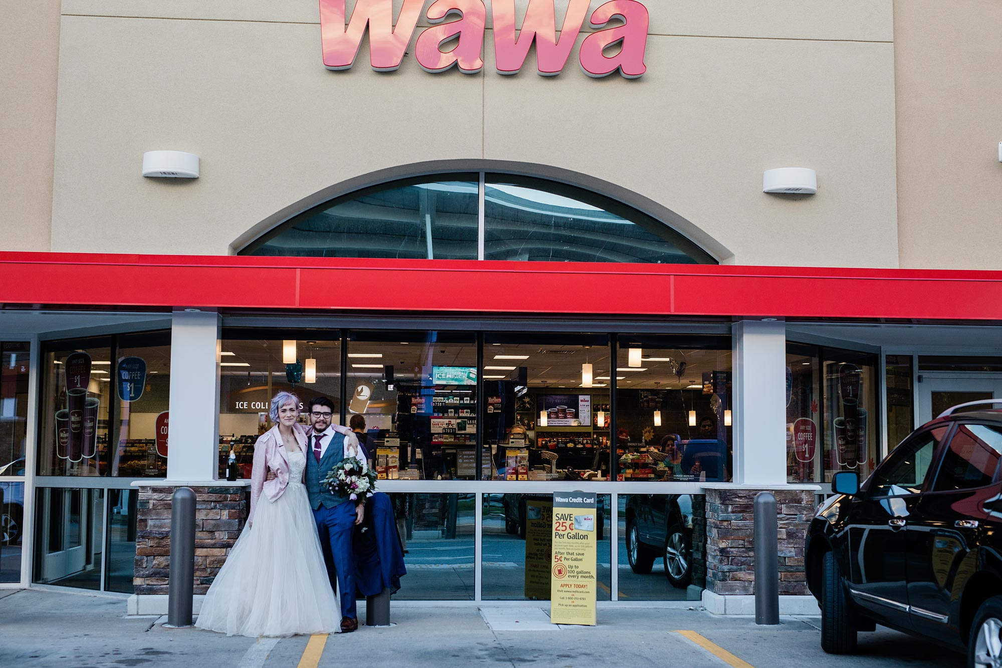 Chic Queer Wedding in West Chester Pennsylvania showing couple in front of Wawa Judson Rappaport Photography