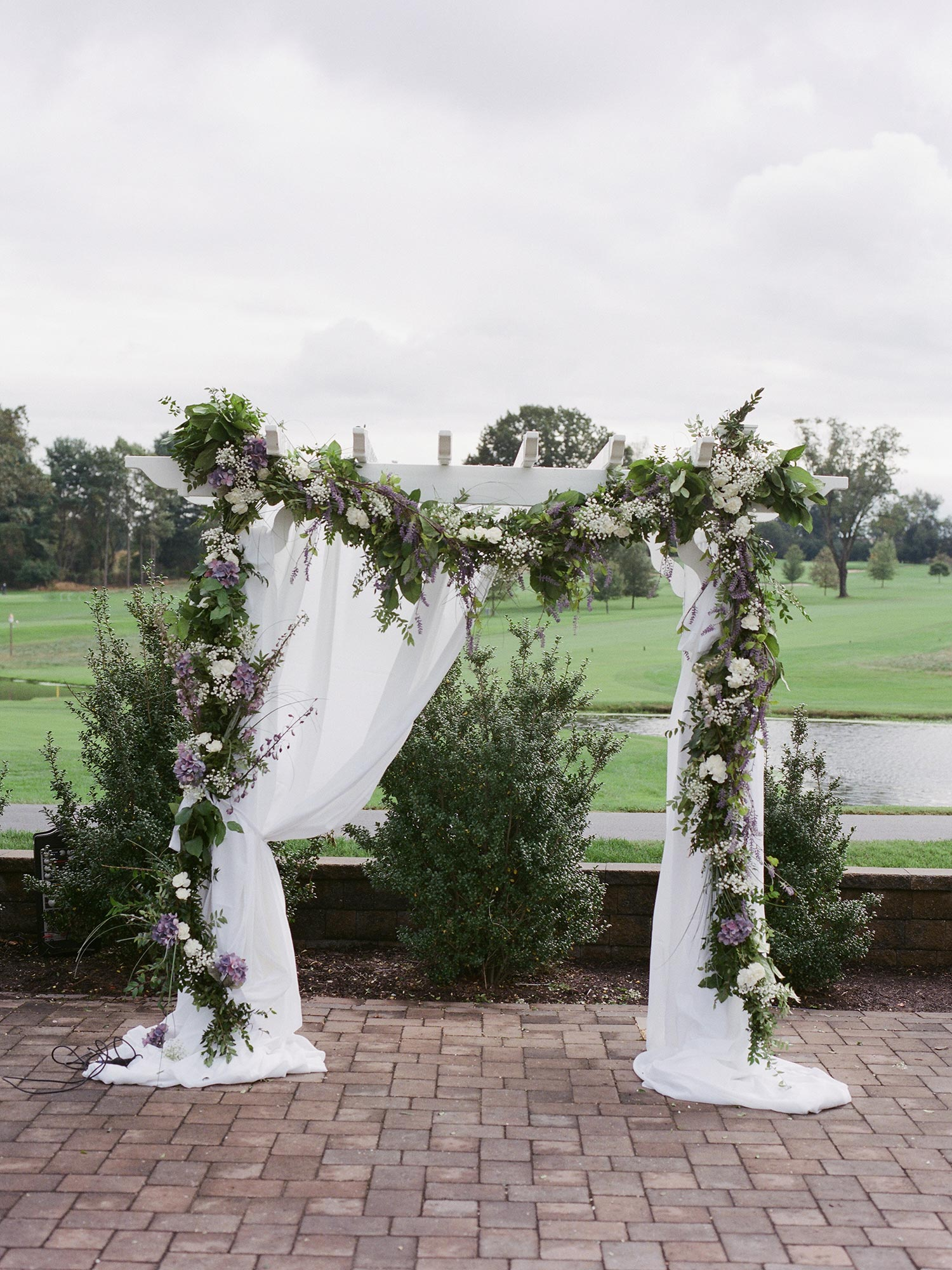 Chic Queer Wedding in West Chester Pennsylvania showing floral wedding arbor Judson Rappaport Photography