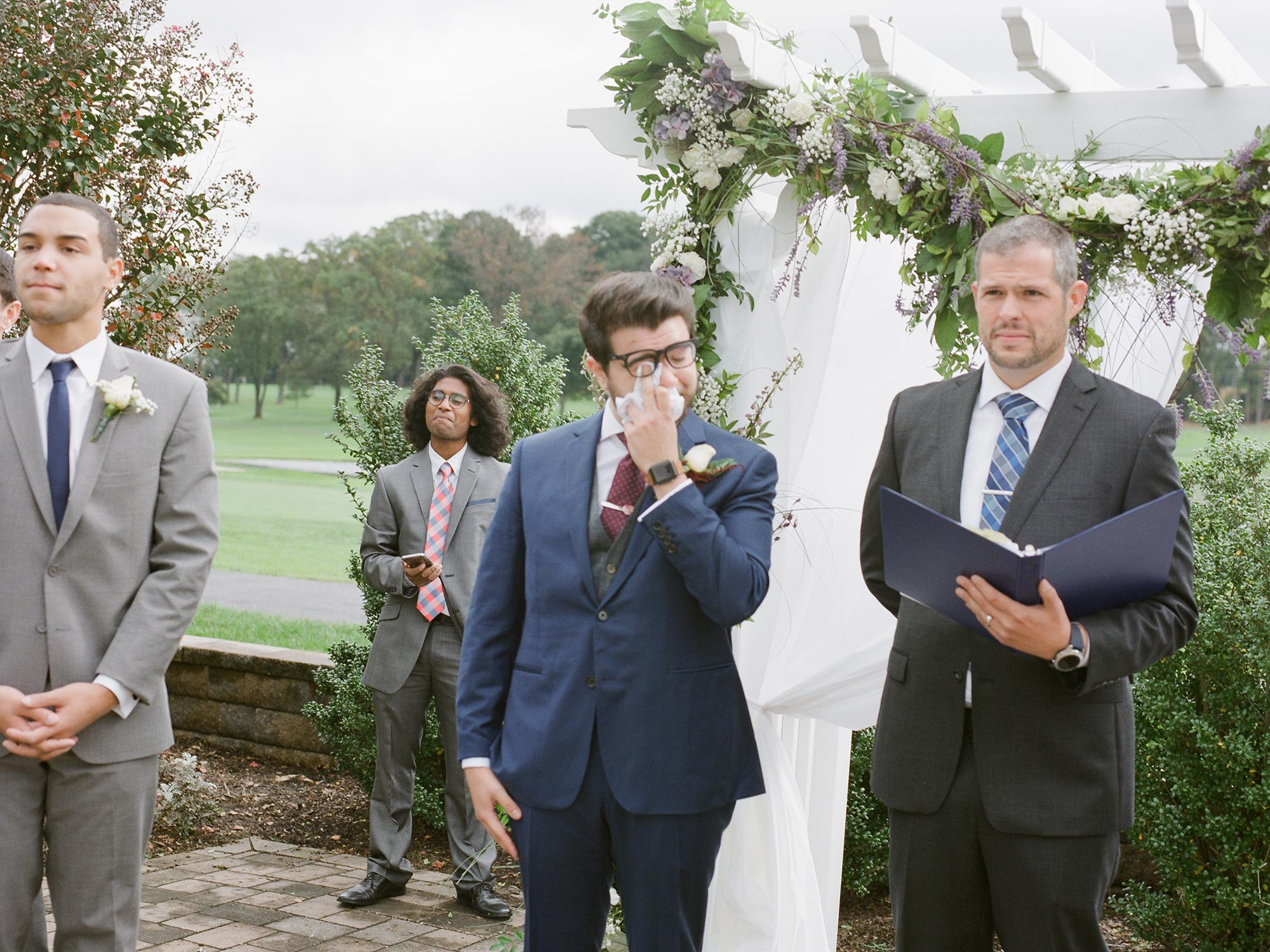 Chic Queer Wedding in West Chester Pennsylvania showing David crying as Sara walks down aisle Judson Rappaport Photography