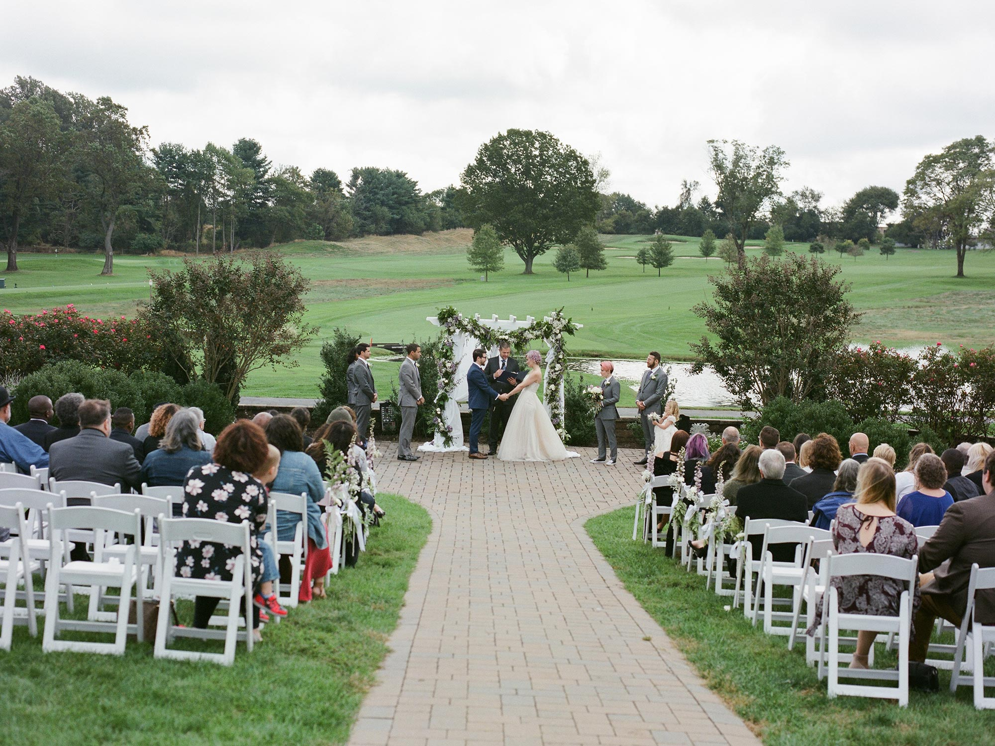 Chic Queer Wedding in West Chester Pennsylvania showing couple exchanging vows Judson Rappaport Photography