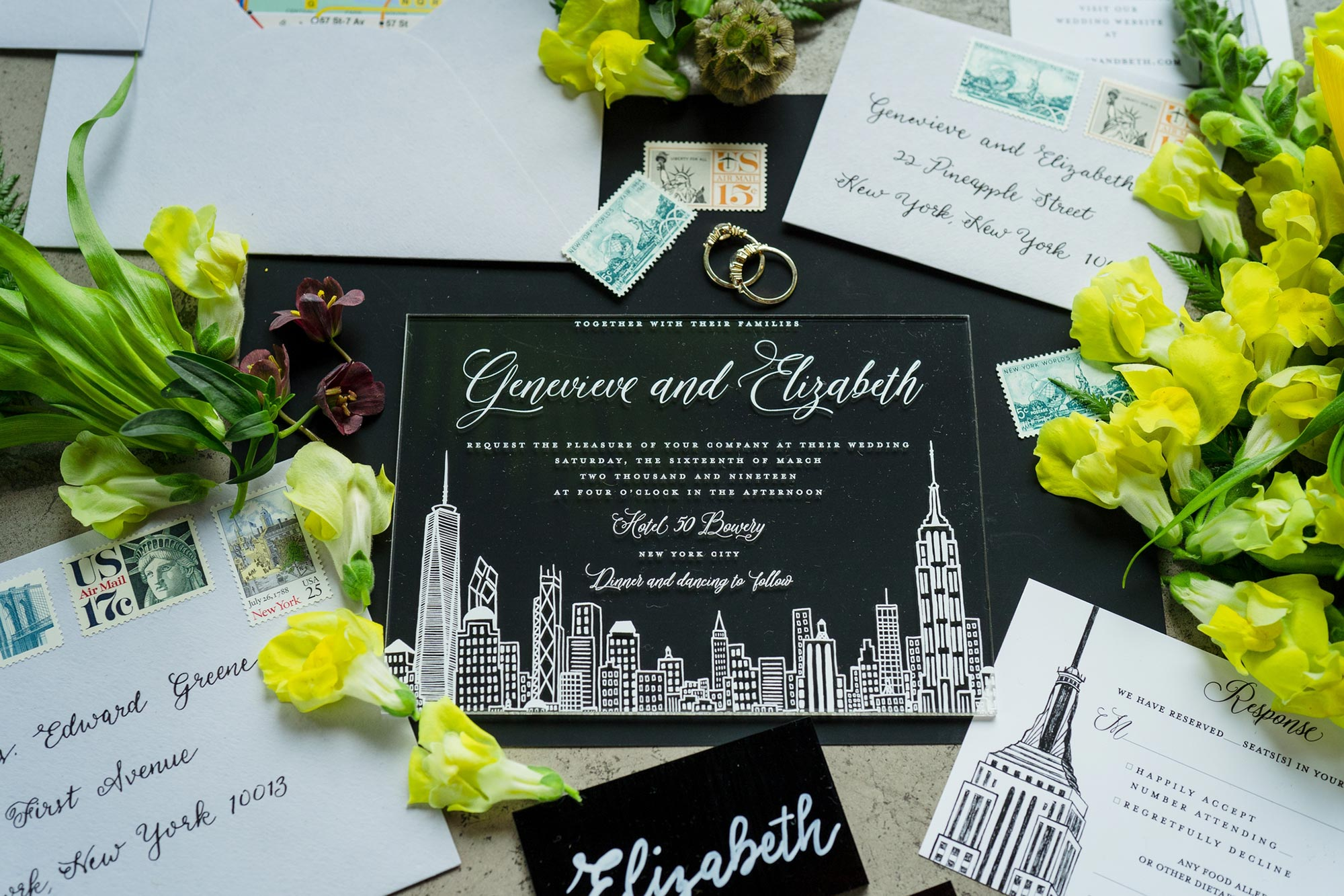 Bright Neon Wedding Inspiration at The Bowery Hotel NYC showing wedding invitations and rings JC Lemon Photography