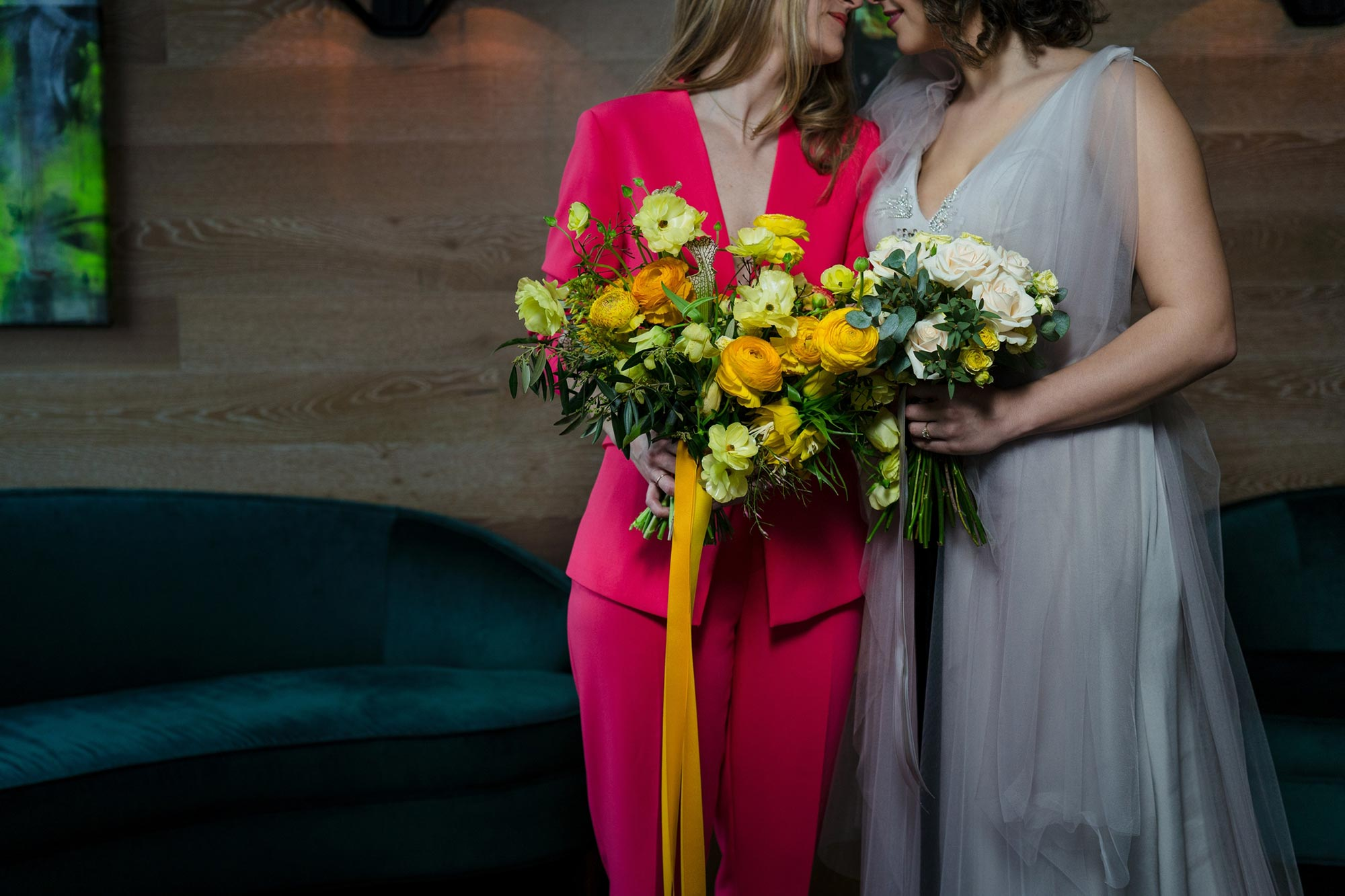 Bright Neon Wedding Inspiration at The Bowery Hotel NYC showing gray dress neon pink suit and bouquet JC Lemon Photography