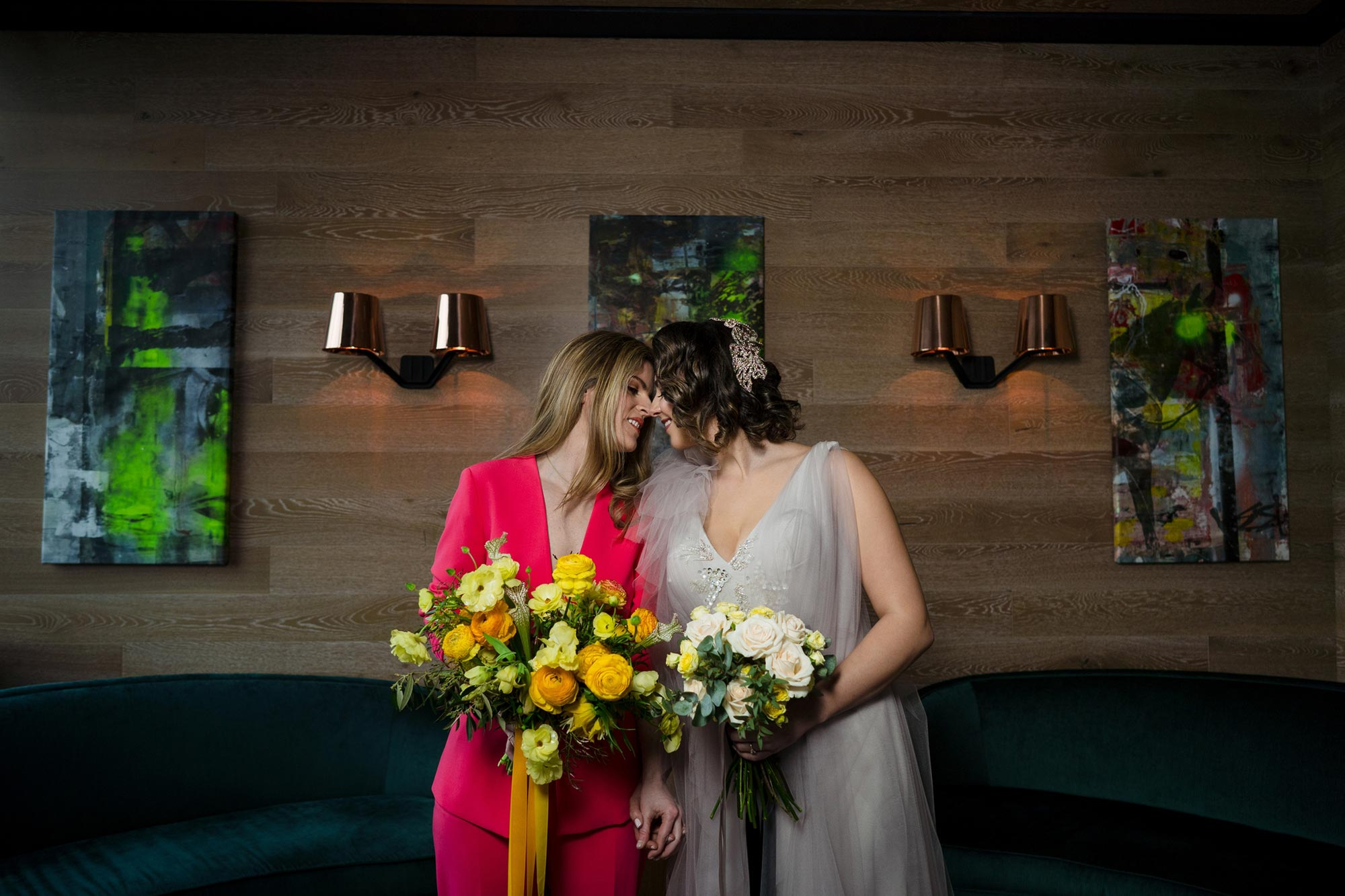 Bright Neon Wedding Inspiration at The Bowery Hotel NYC showing couple leaning in for kiss JC Lemon Photography