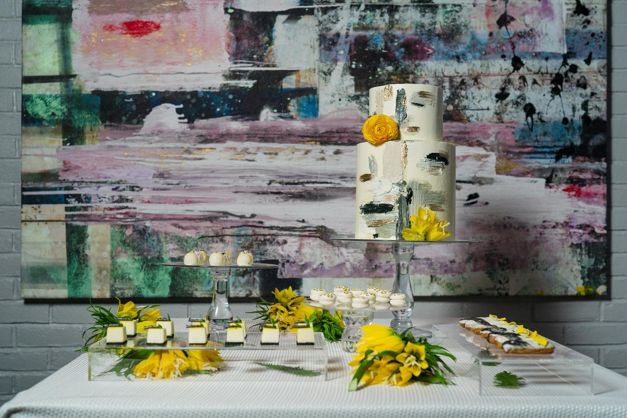 Bright Neon Wedding Inspiration at The Bowery Hotel NYC showing wedding cake and yellow desserts JC Lemon Photography