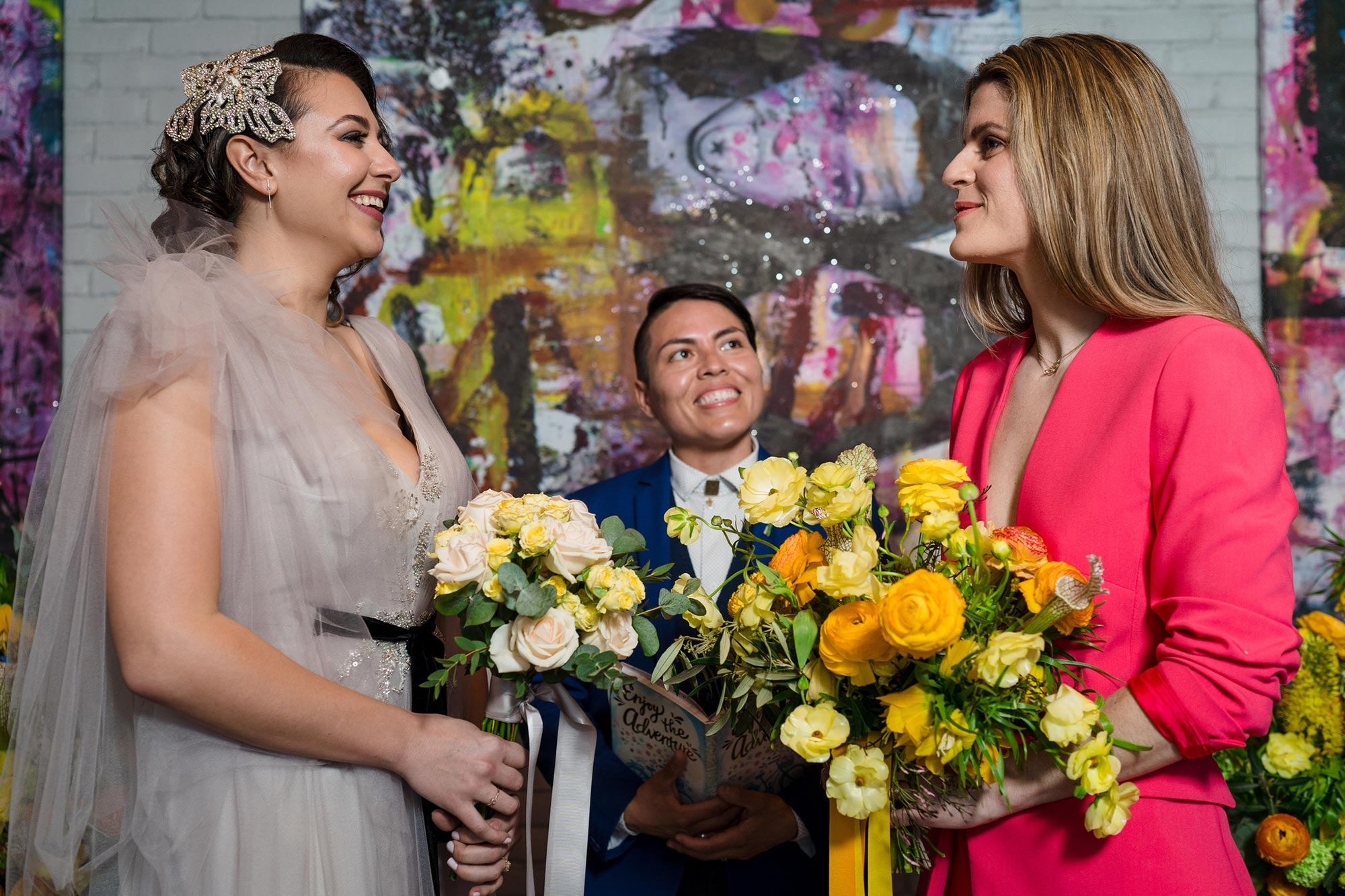 Bright Neon Wedding Inspiration at The Bowery Hotel NYC showing couple during ceremony JC Lemon Photography