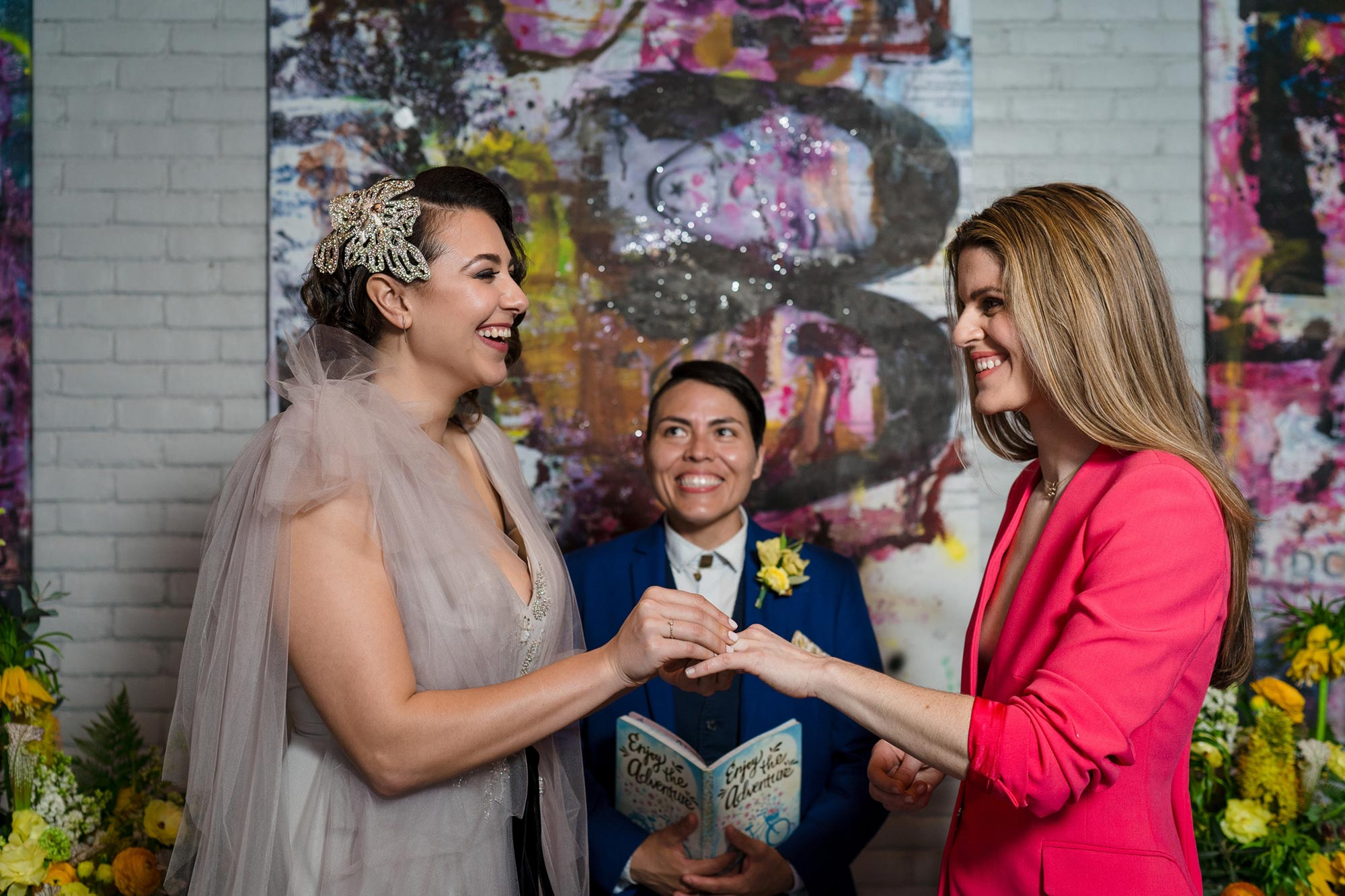 Bright Neon Wedding Inspiration at The Bowery Hotel NYC showing couple exchanging rings JC Lemon Photography