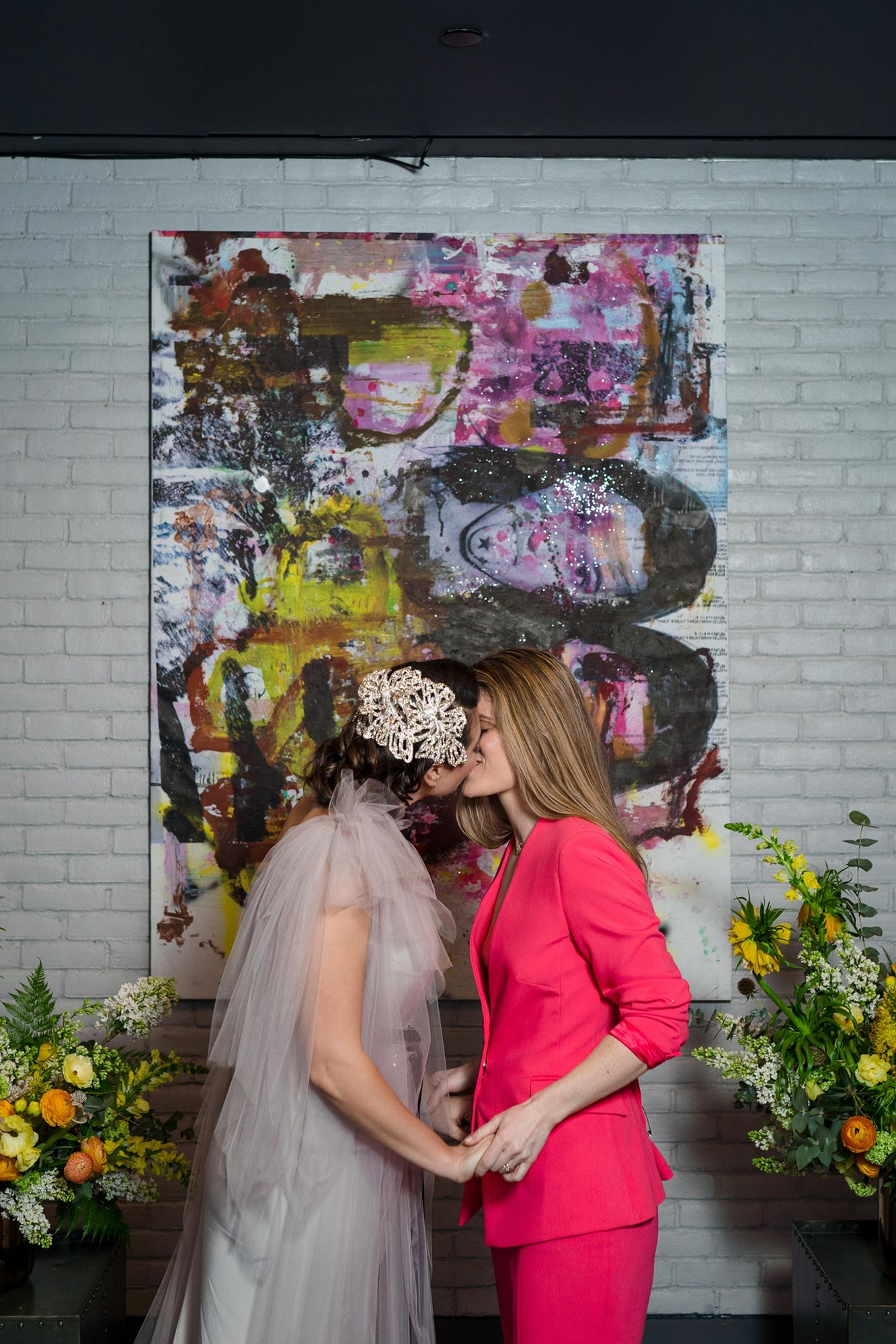Bright Neon Wedding Inspiration at The Bowery Hotel NYC showing couple kissing after ceremony JC Lemon Photography