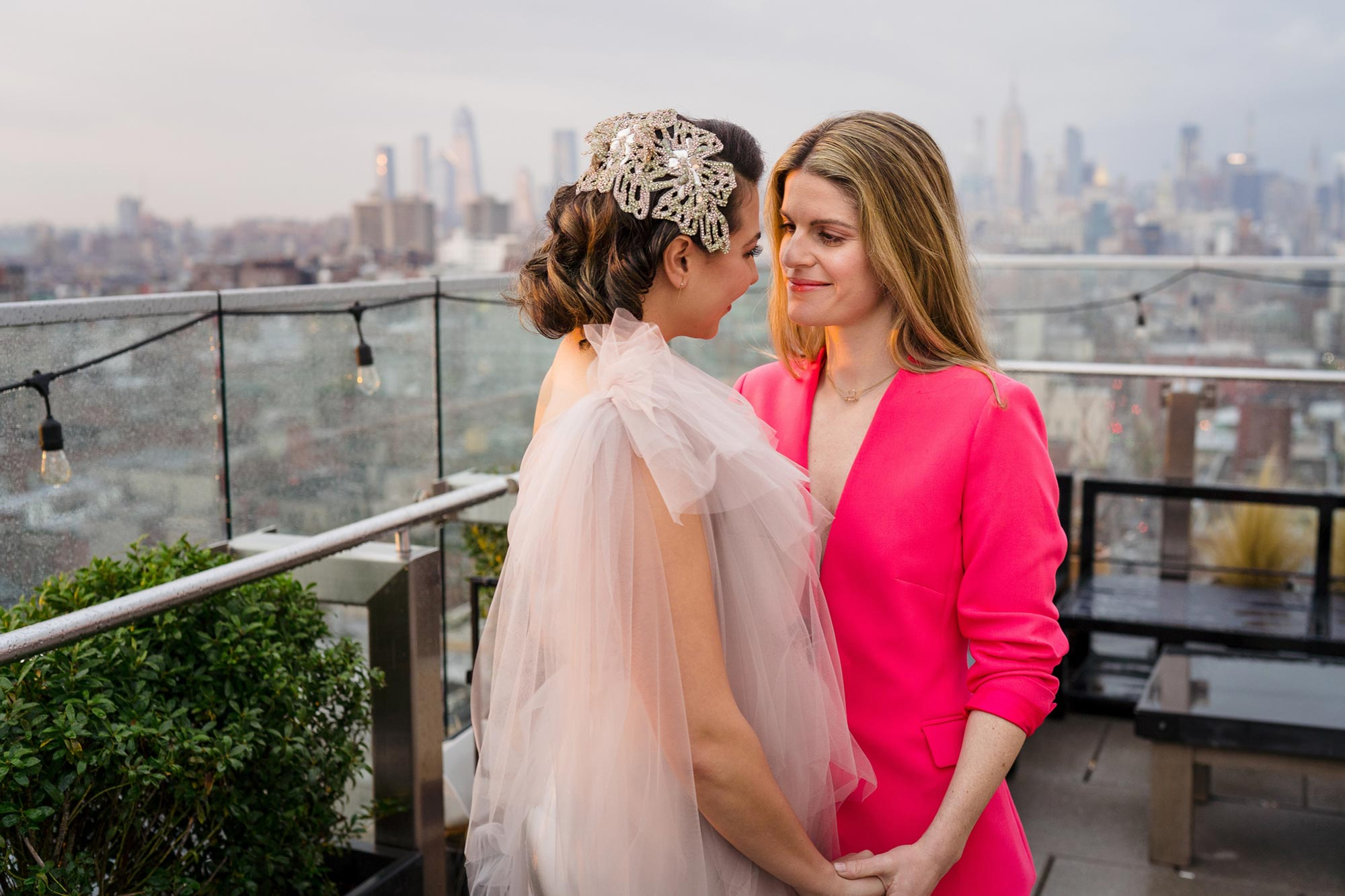 Bright Neon Wedding Inspiration at The Bowery Hotel NYC showing couple on rooftop with city in background JC Lemon Photography