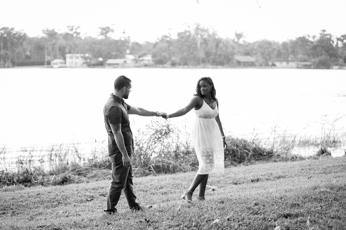 CYPRESS GROVE ENGAGEMENT SESSION CRYSTAL LILY PHOTOGRAPHY COUPLE HOLDING HANDS WALKING BY LAKE
