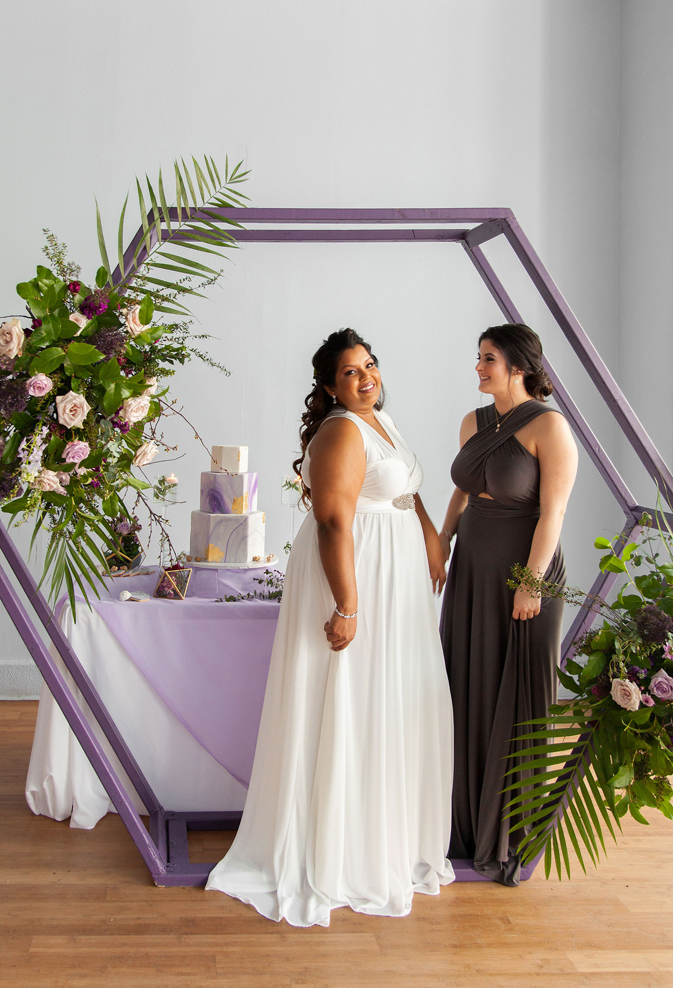 Henkaa fall wedding collection with bride in white and bridesmaid in gray
