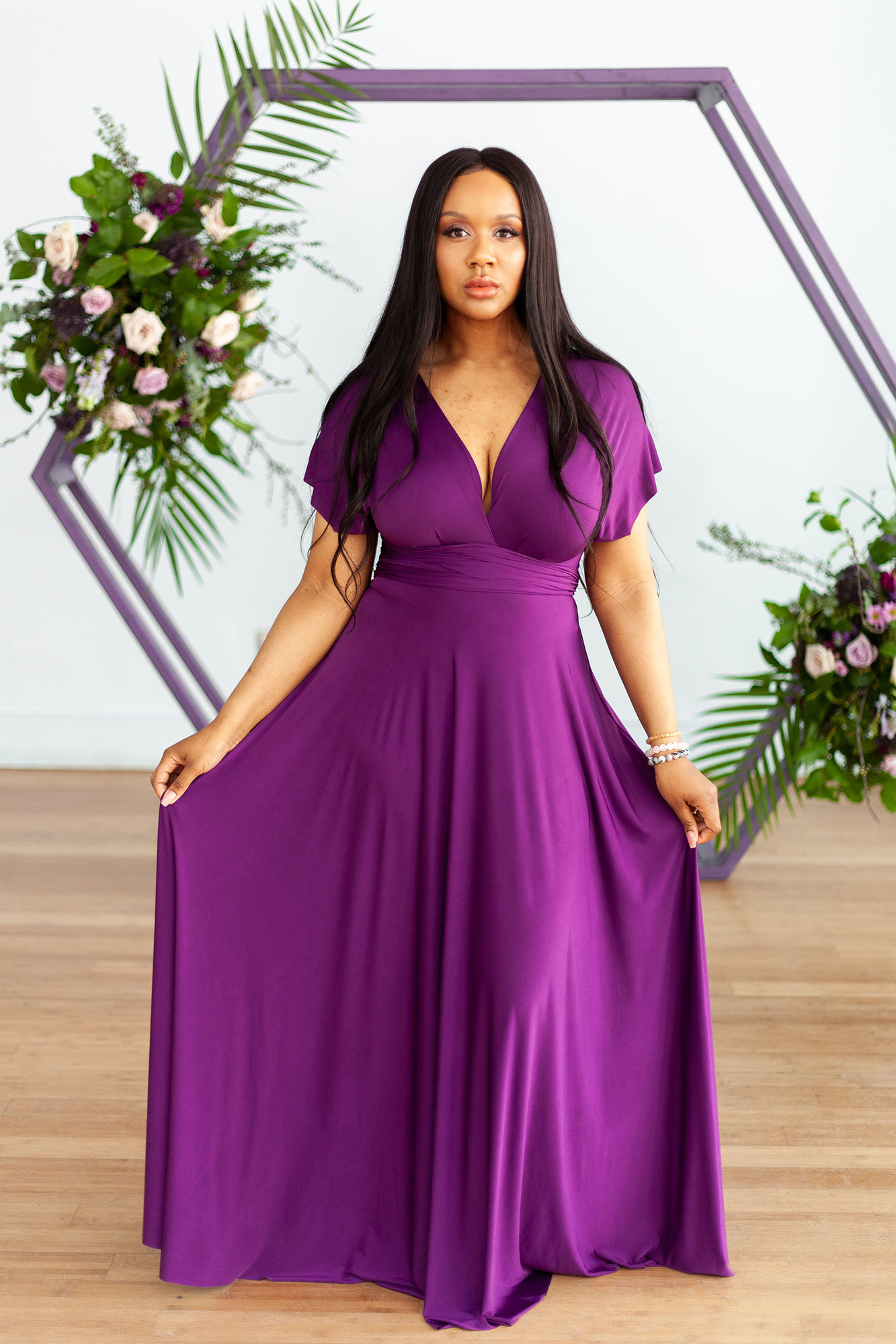 Henkaa fall wedding collection with bridesmaid in plum purple dress