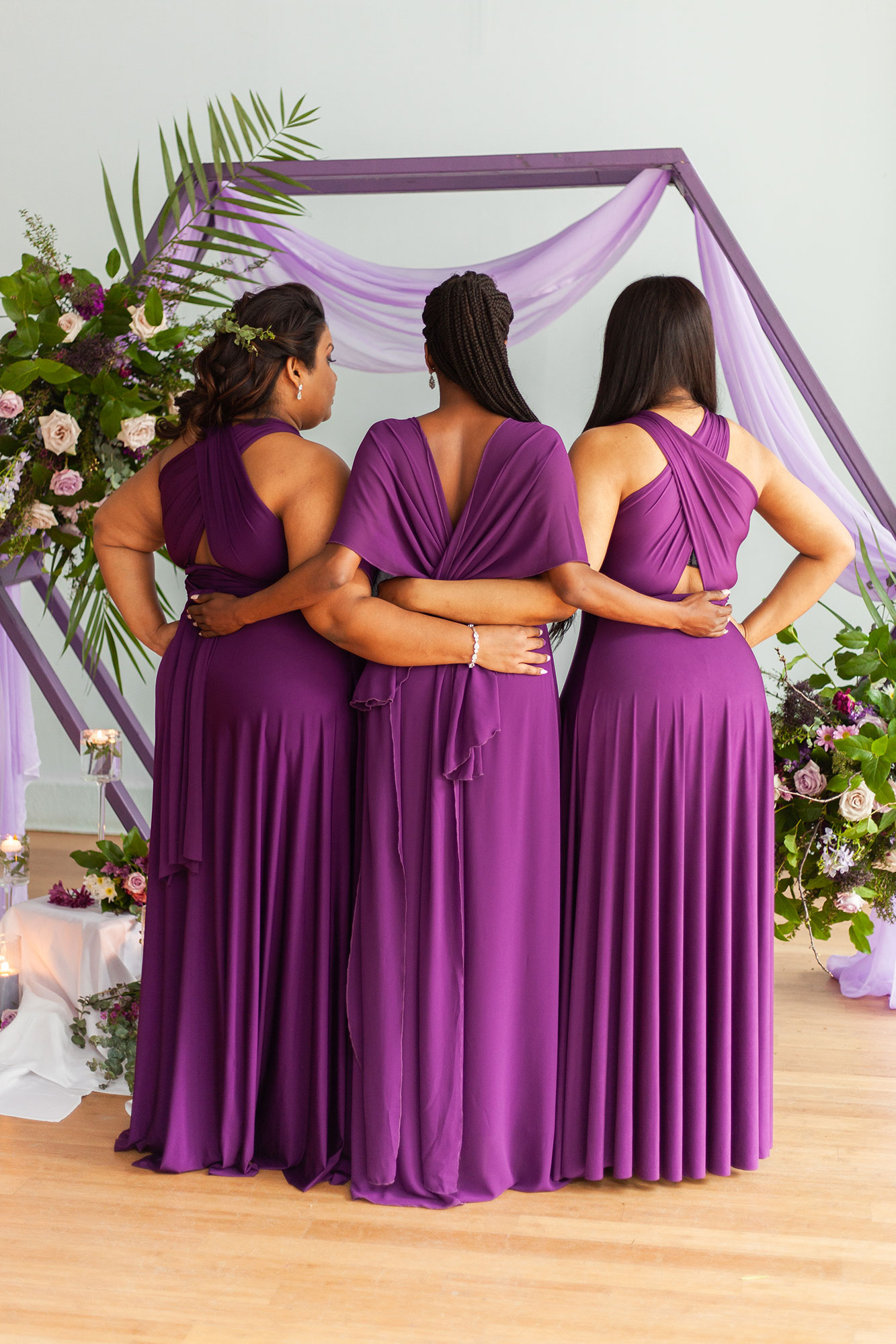 Henkaa fall wedding collection with bridesmaids in purple dresses