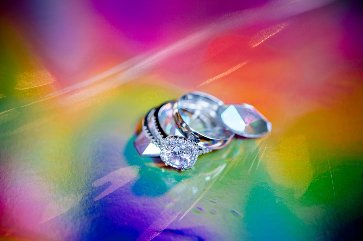 RAINBOW QUEER WEDDING INSPIRATION MICHELLE SCHAPIRO, DEANNA NAGLE, RINGS ON IRIDESCENT RAINBOW SURFACE