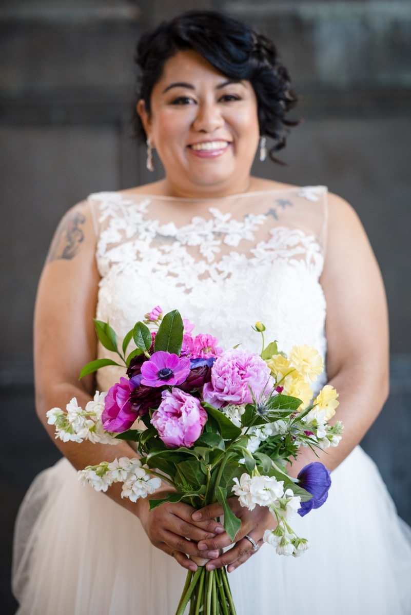 RAINBOW QUEER WEDDING INSPIRATION MICHELLE SCHAPIRO, DEANNA NAGLE, model holding bouquet