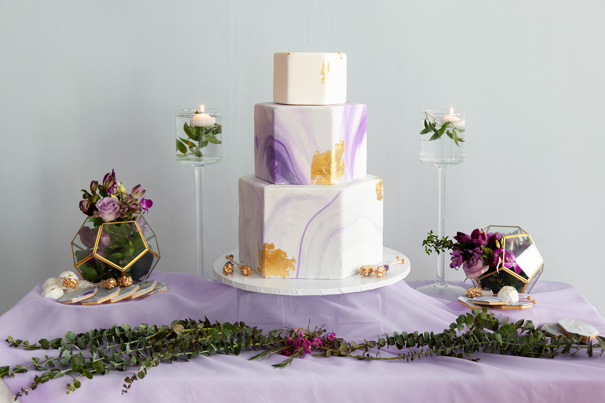 Henkaa fall wedding collection with purple and gold hexagon three tier wedding cake