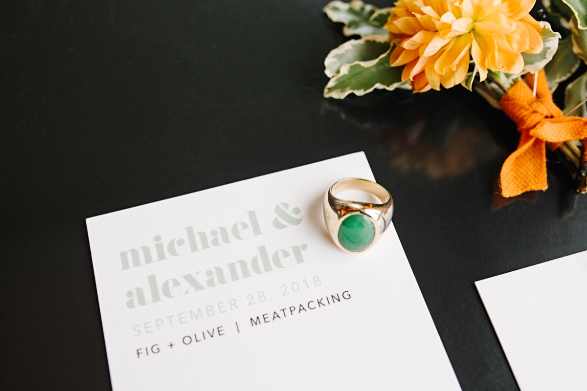 modern mediterranean wedding meatpacking district new york city rima brindamour photography invitation with jade and gold ring