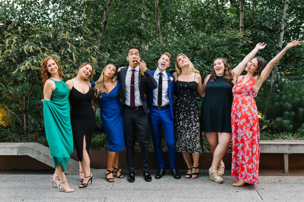 modern mediterranean wedding meatpacking district new york city rima brindamour photography grooms in fun photo with guests