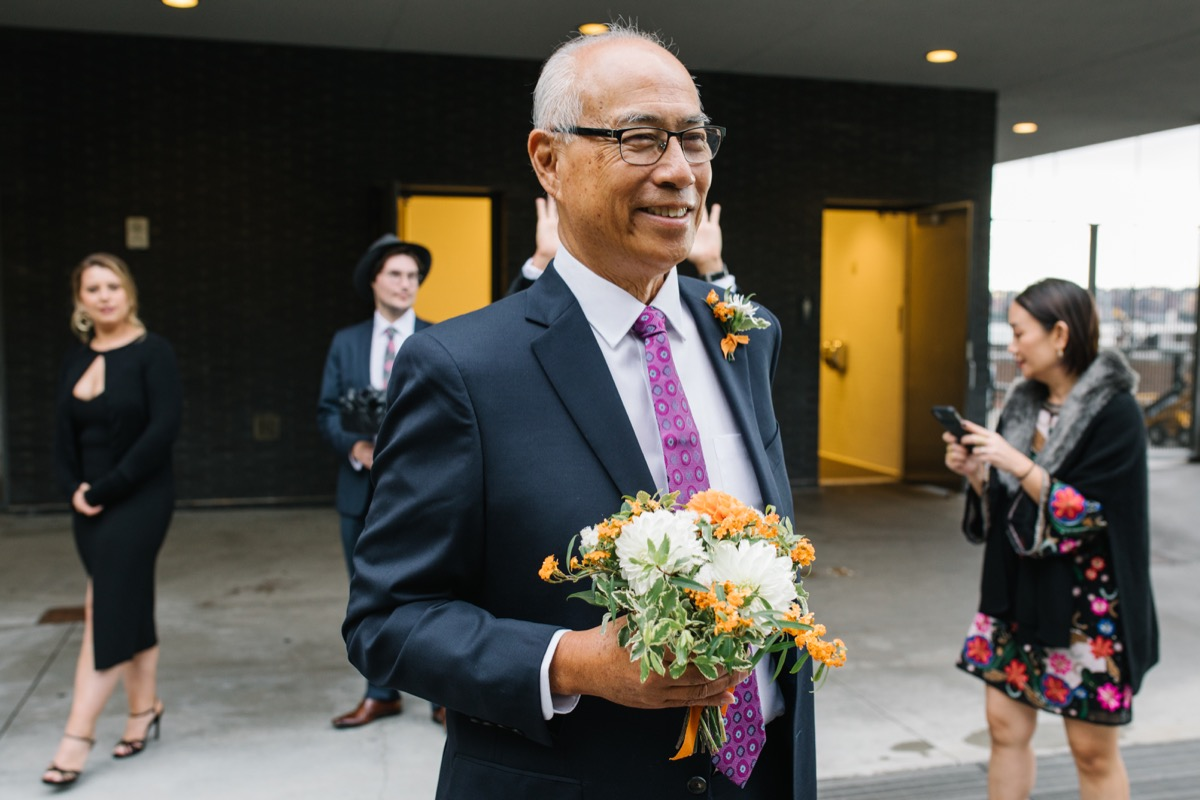 modern mediterranean wedding meatpacking district new york city rima brindamour photography alex' father holding flowers