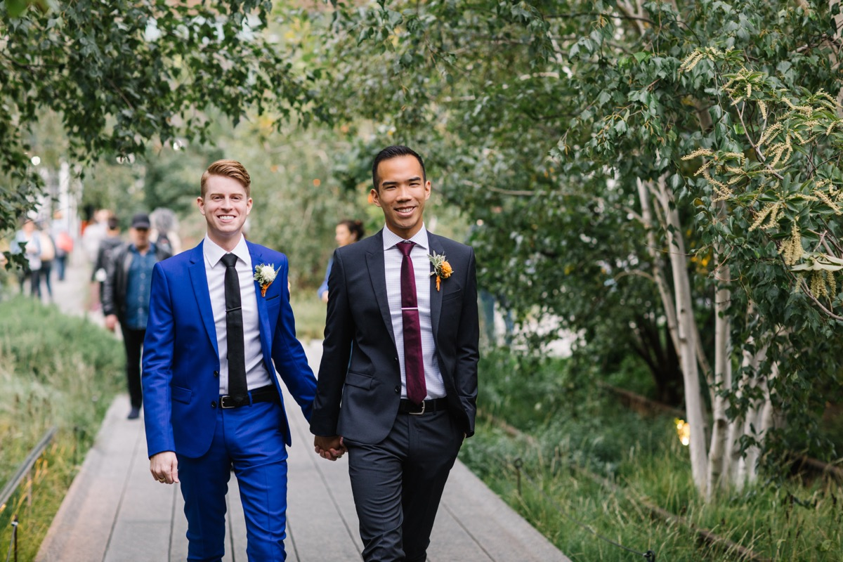 modern mediterranean wedding meatpacking district new york city rima brindamour photography alex and michael holding hands walking down path