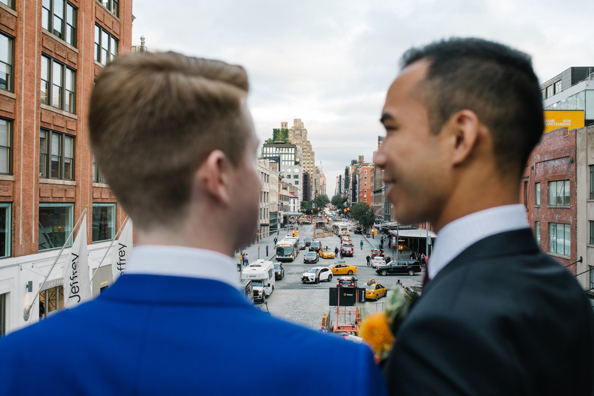 modern mediterranean wedding meatpacking district new york city rima brindamour photography grooms overlooking city