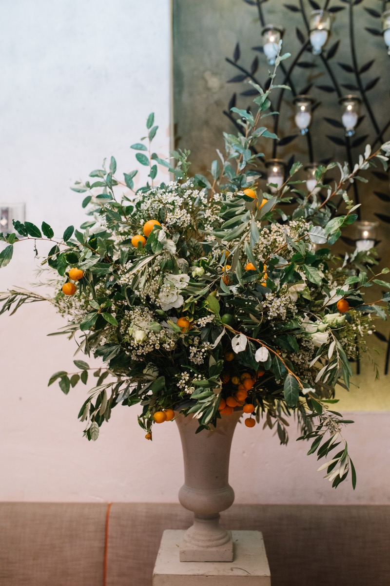 modern mediterranean wedding meatpacking district new york city rima brindamour photography stone vase with flowers and oranges
