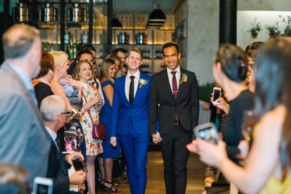 modern mediterranean wedding meatpacking district new york city rima brindamour photography grooms entering ceremony