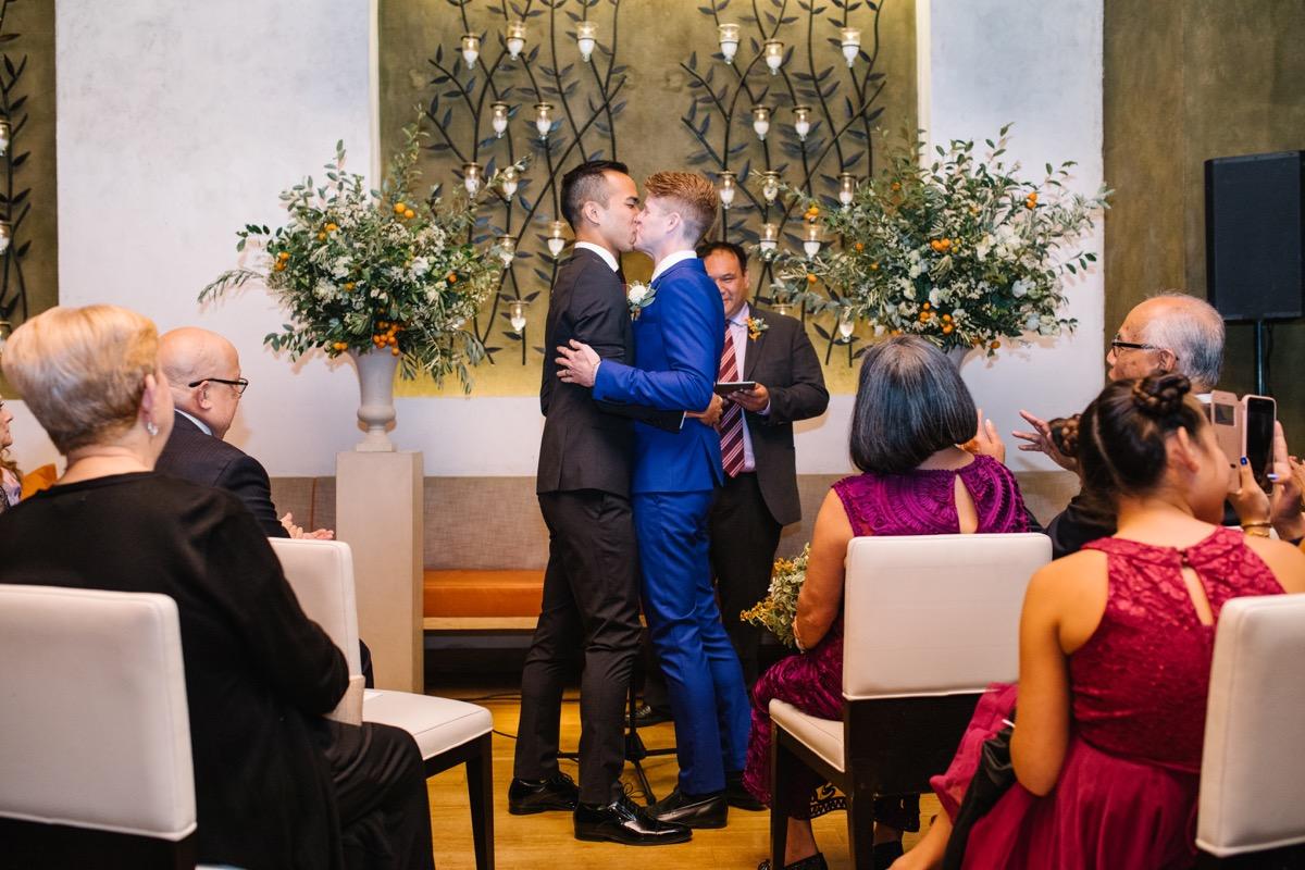 modern mediterranean wedding meatpacking district new york city rima brindamour photography ceremony kiss