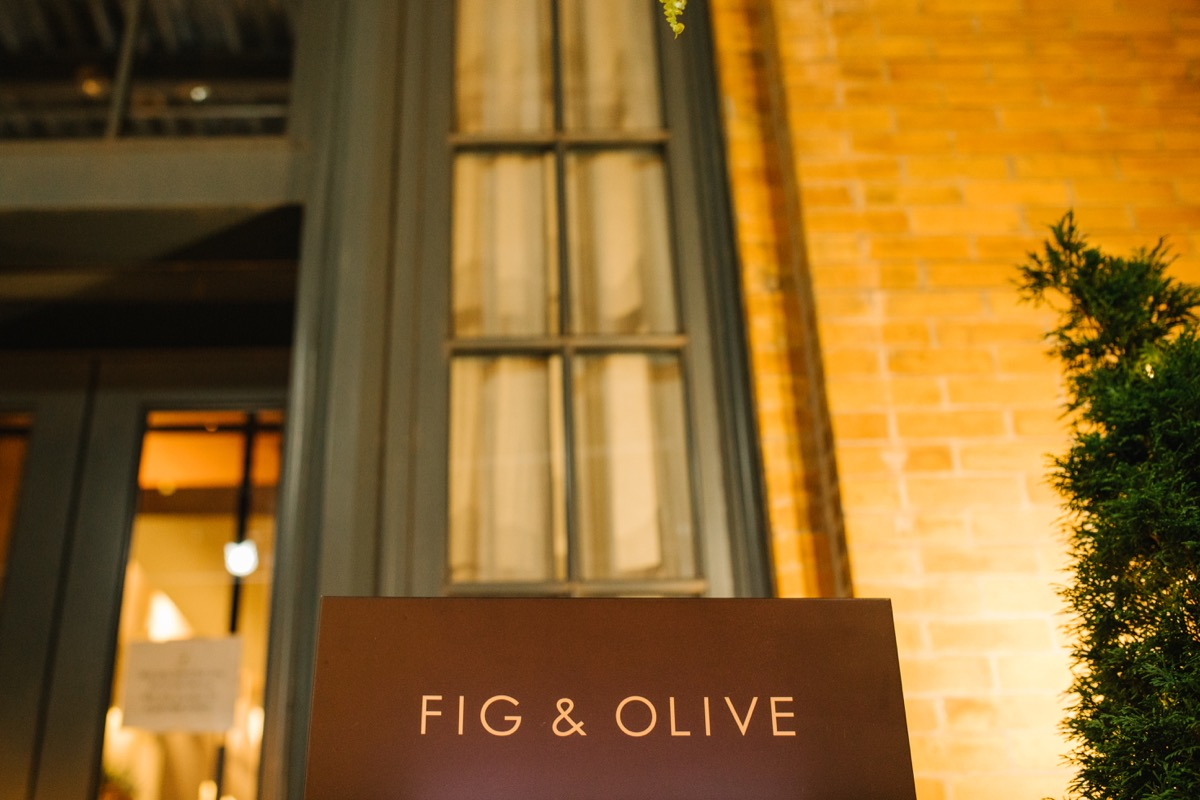 modern mediterranean wedding meatpacking district new york city rima brindamour photography fig and olive restaurant sign