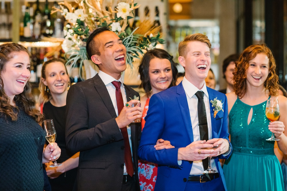 modern mediterranean wedding meatpacking district new york city rima brindamour photography grooms and guests laughing