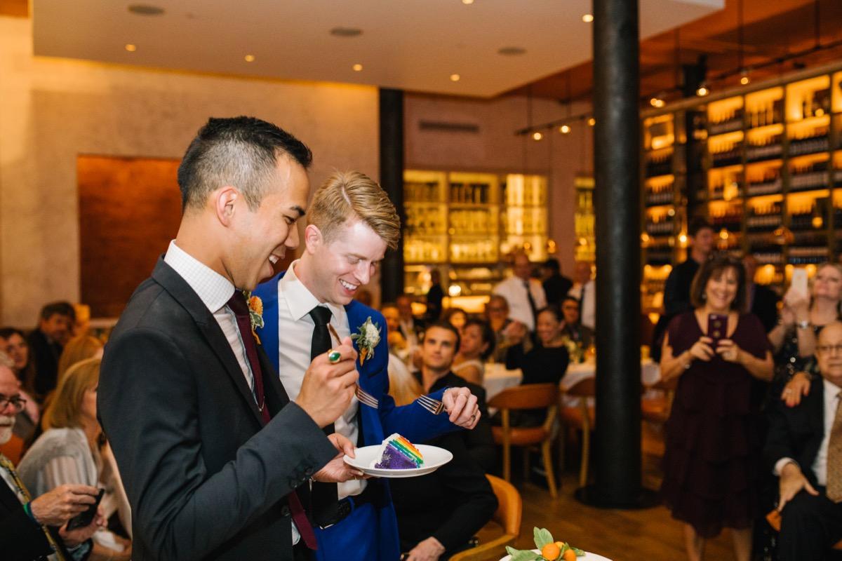 modern mediterranean wedding meatpacking district new york city rima brindamour photography grooms eating rainbow cake