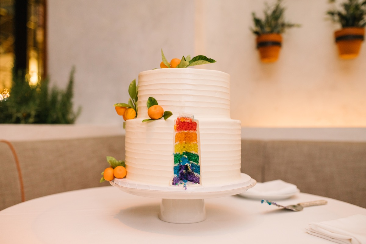 modern mediterranean wedding meatpacking district new york city rima brindamour photography cake with slice cut out