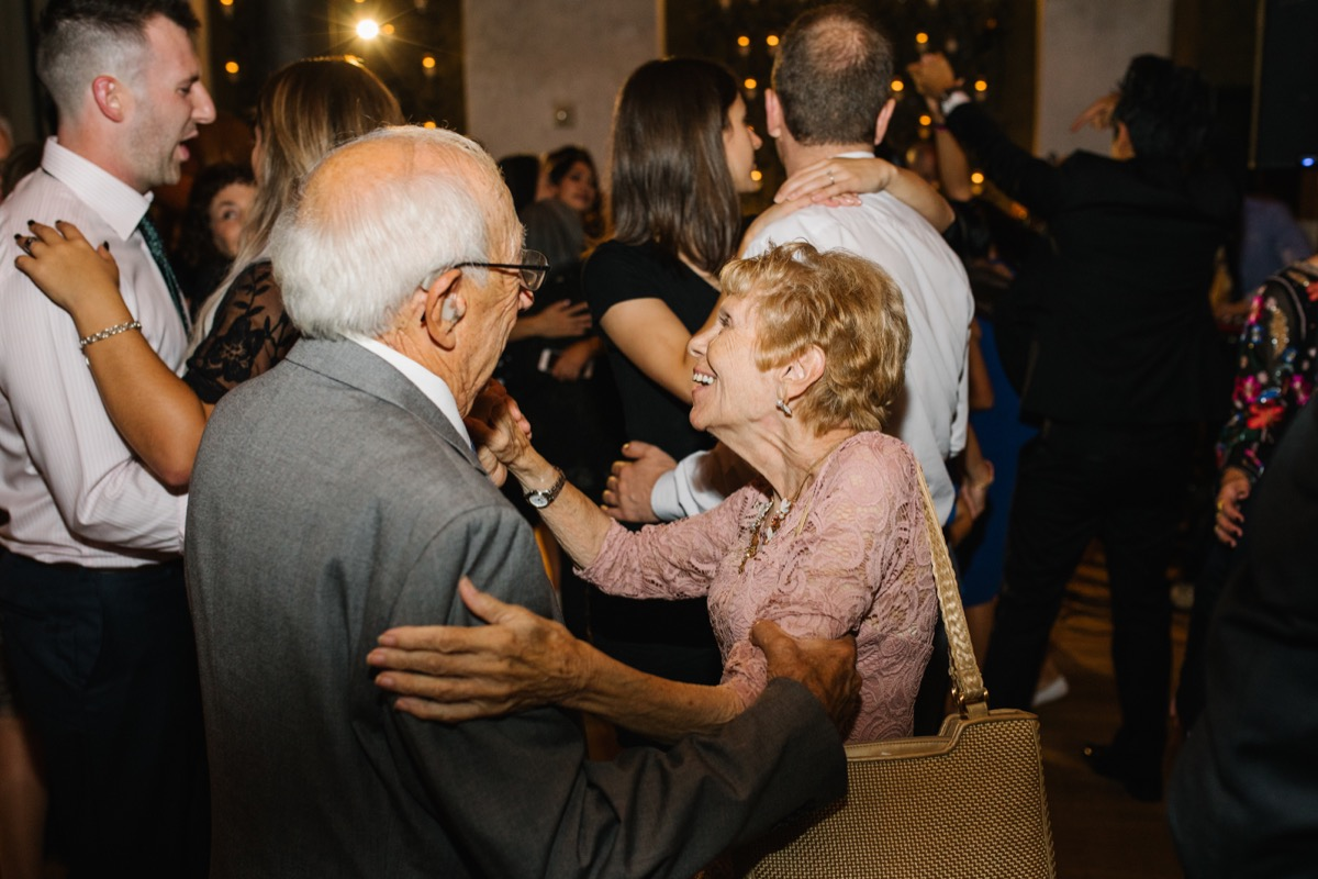 modern mediterranean wedding meatpacking district new york city rima brindamour photography guests dancing