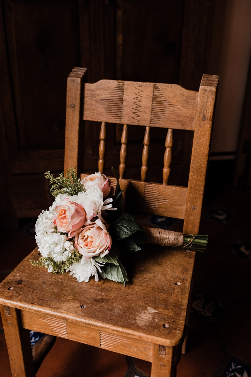 lAVENDER FARM WEDDING ALBUQUERQUE NEW MEXICO ALICIA LUCIA PHOTOGRAPHY BOUQUET ON WOODEN CHAIR