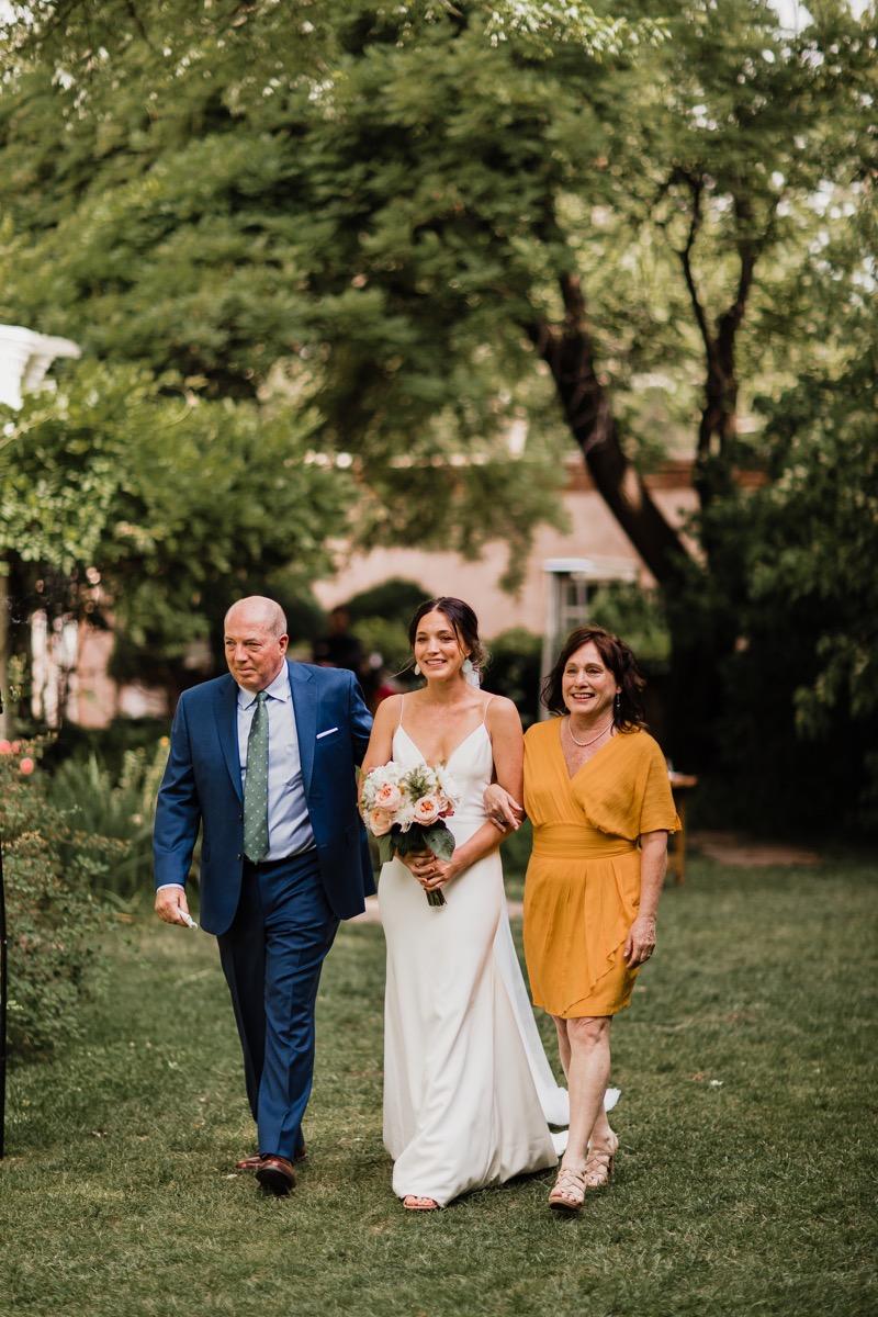 lAVENDER FARM WEDDING ALBUQUERQUE NEW MEXICO ALICIA LUCIA PHOTOGRAPHY CARA WALKING WITH PARENTS