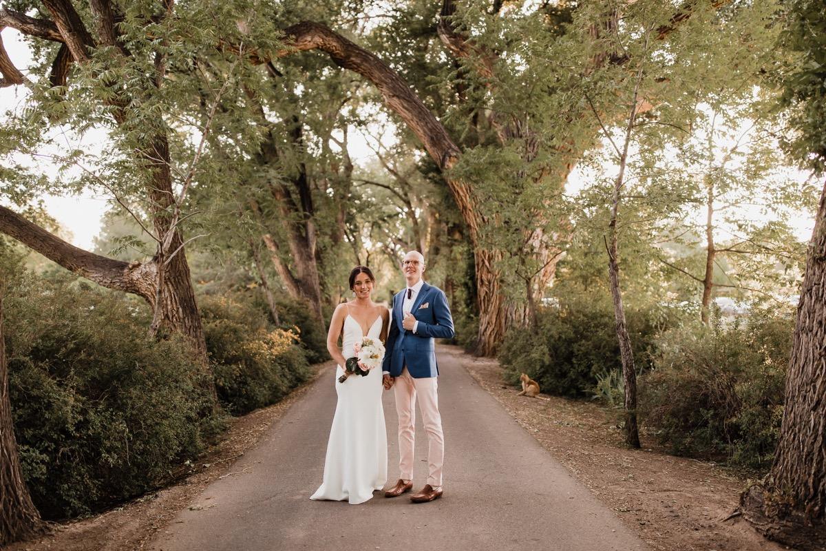 lAVENDER FARM WEDDING ALBUQUERQUE NEW MEXICO ALICIA LUCIA PHOTOGRAPHY COUPLE ON WOODS PATH