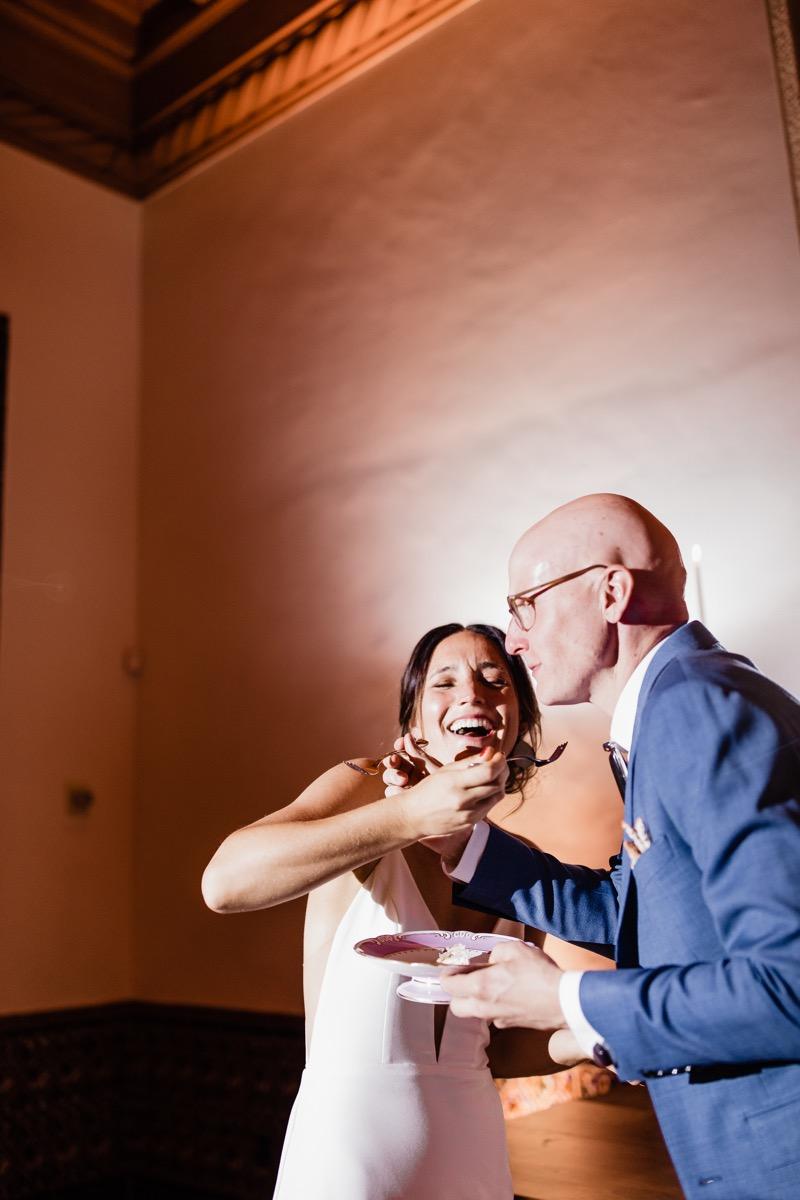 lAVENDER FARM WEDDING ALBUQUERQUE NEW MEXICO ALICIA LUCIA PHOTOGRAPHY CARA AND QWIST FEEDING EACH OTHER CAKE