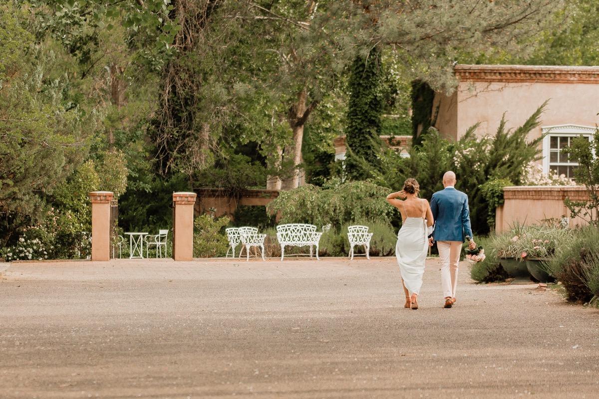 lAVENDER FARM WEDDING ALBUQUERQUE NEW MEXICO ALICIA LUCIA PHOTOGRAPHY COUPLE WALKING AWAY HOLDING HANDS