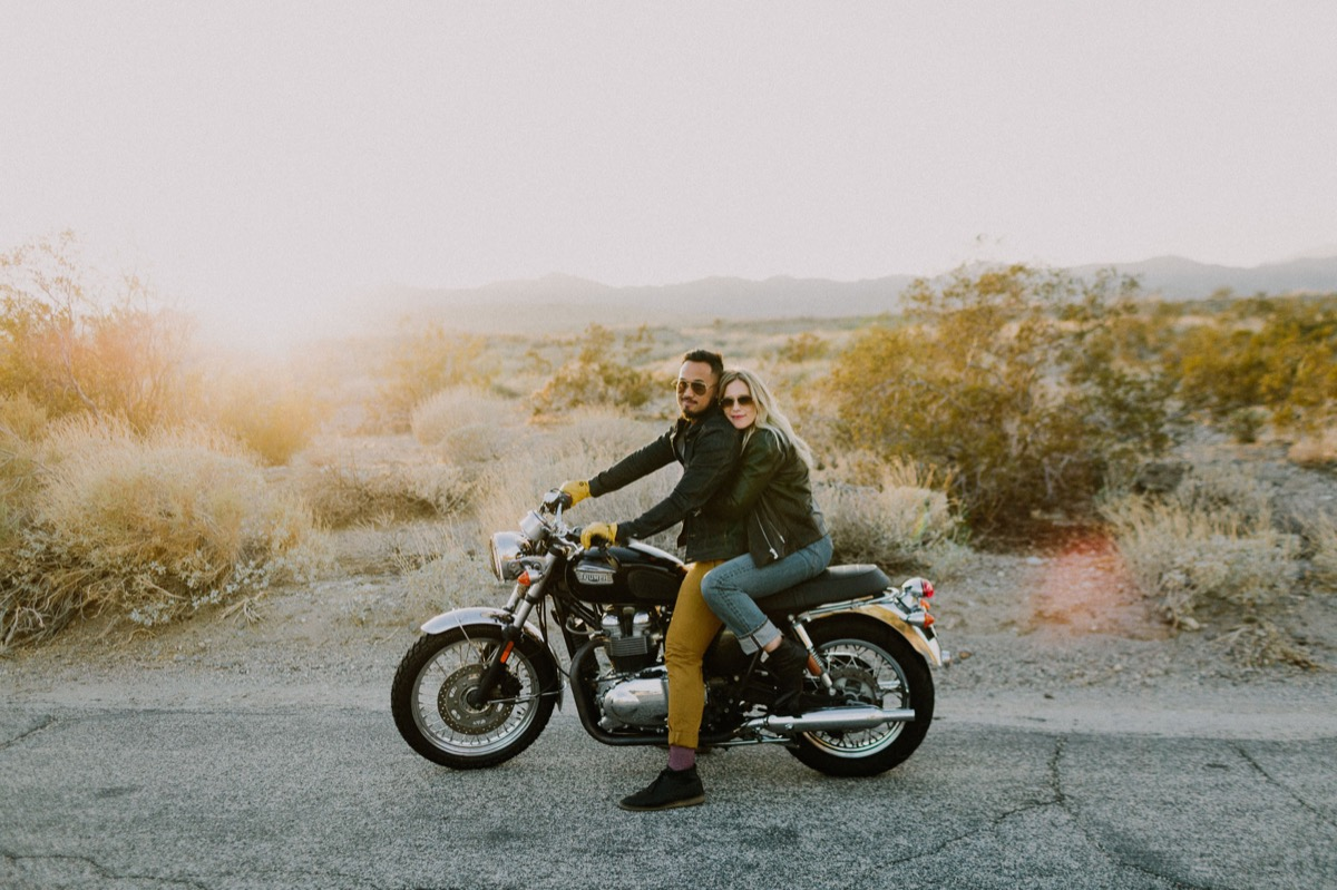 palm springs motorcycle session let's frolic together photography couple on motorcycle wearing sunglasses