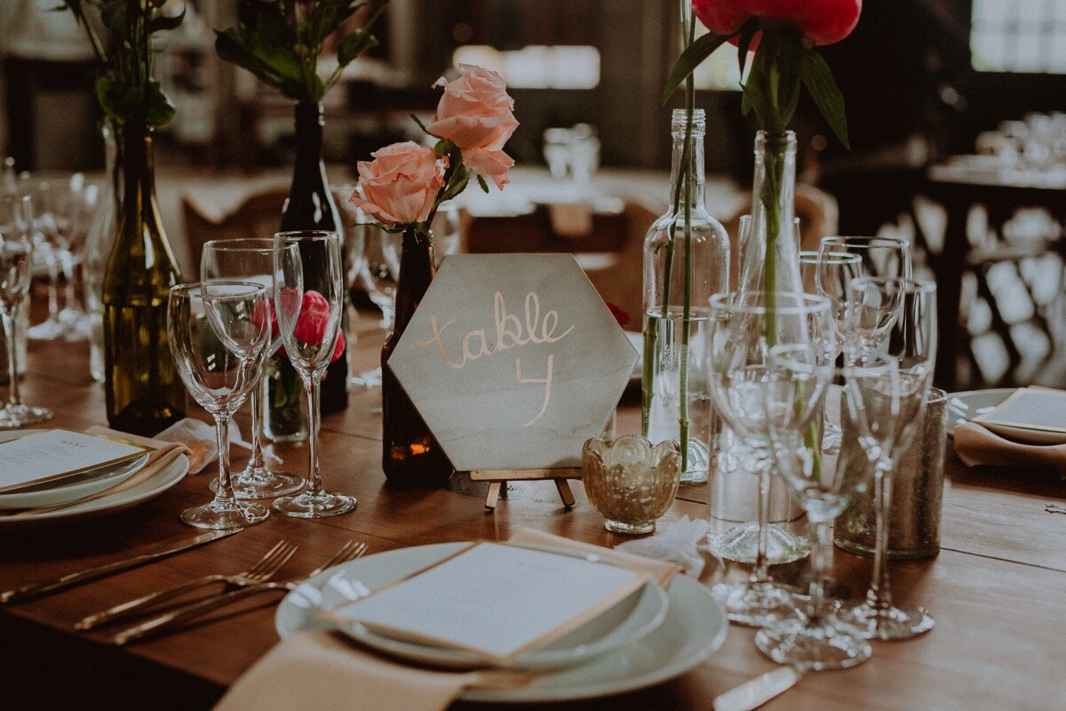 Guest table four place setting for reception at industrial wedding venue in Hudson New York Chellise Michael Photography