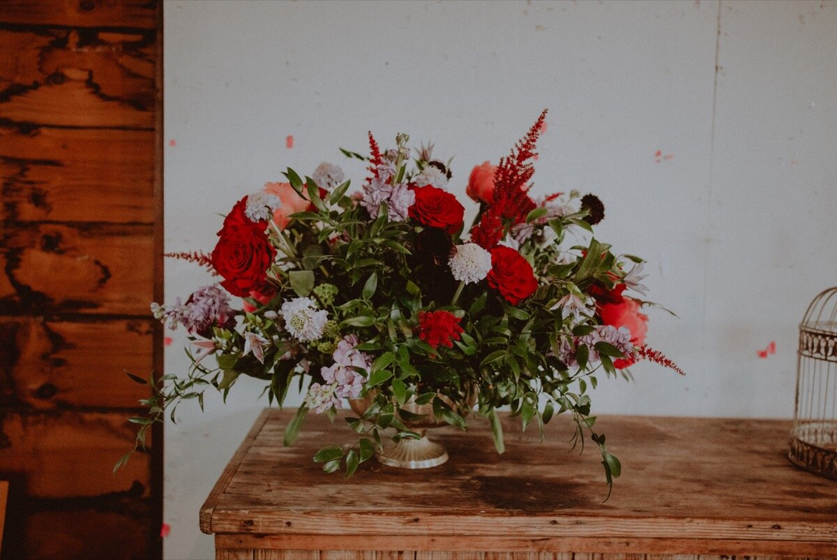 Floral centerpiece at reception at industrial wedding venue in Hudson New York Chellise Michael Photography
