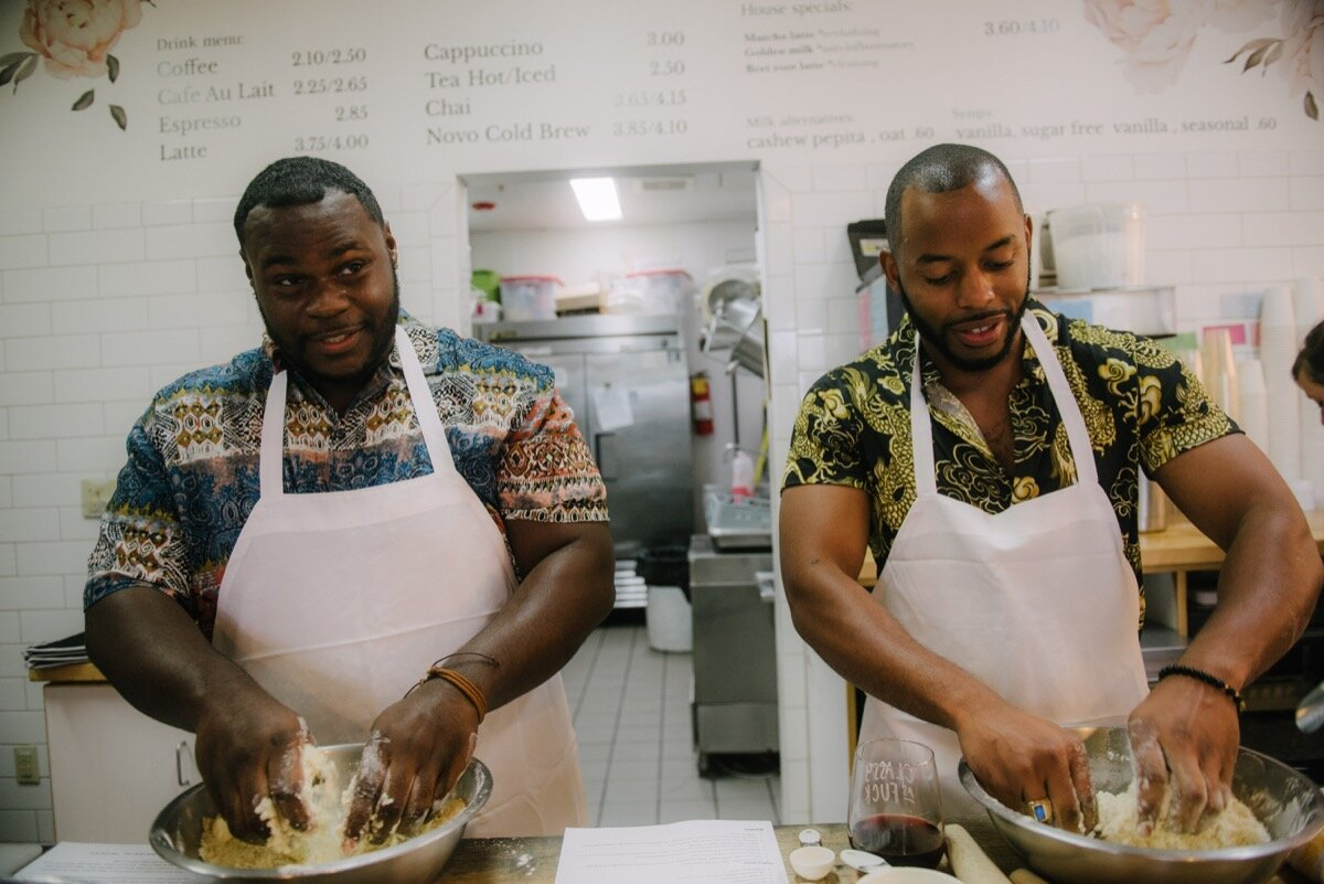 Chris and Nate mix dough at sugar bakeshop denver colorado before surprise proposal Friends and Lovers Photography