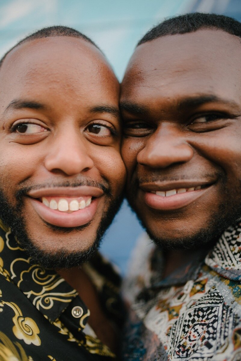 Chris and Nate cheek to cheek after surprise proposal at sugar bakeshop denver colorado Friends and Lovers Photography